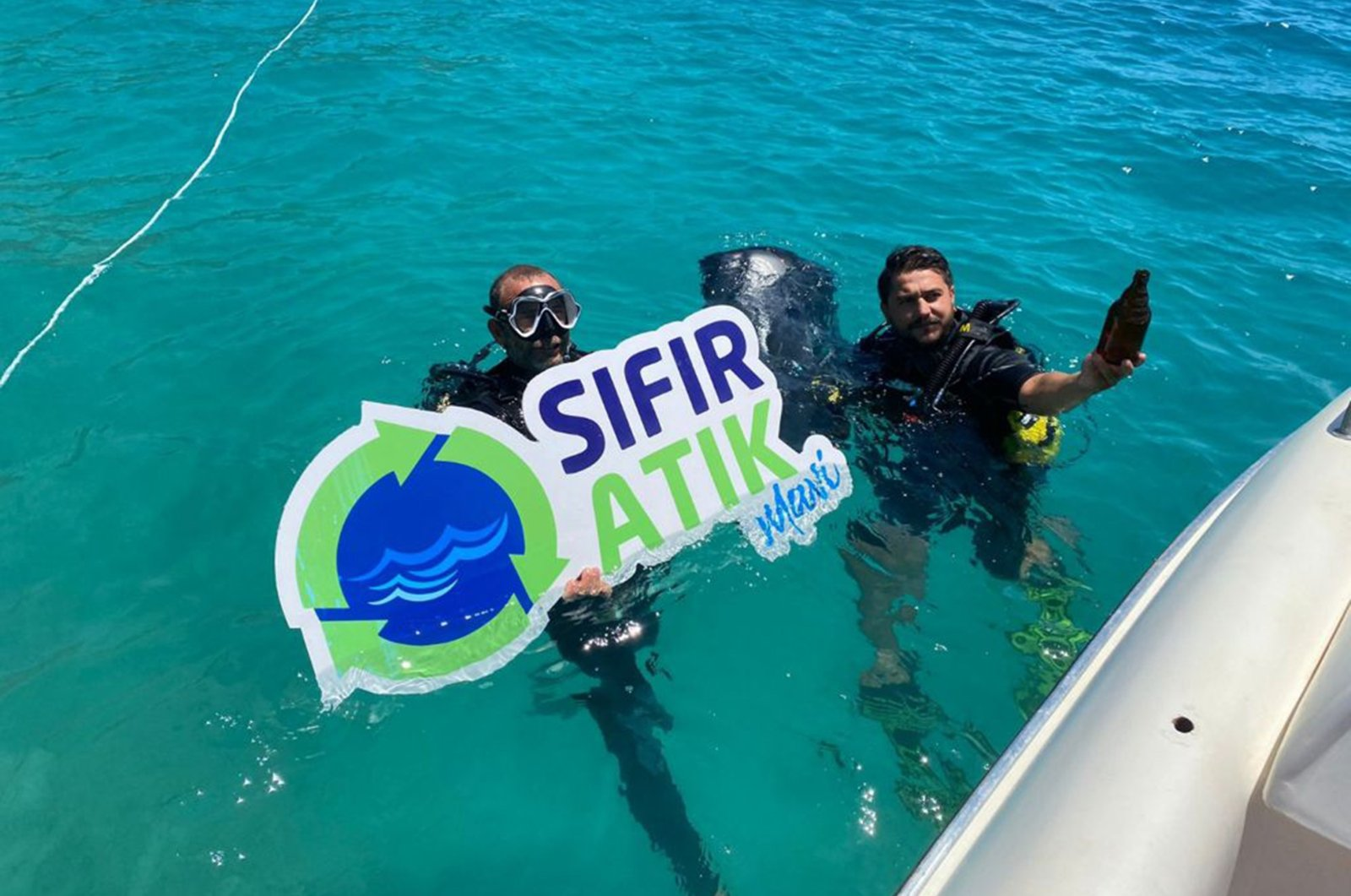 The teams collected the waste materials from the sea in the scope of the Zero Waste project, in Fethiye, Muğla, Southwestern Turkey, June 6, 2021. (IHA Photo)