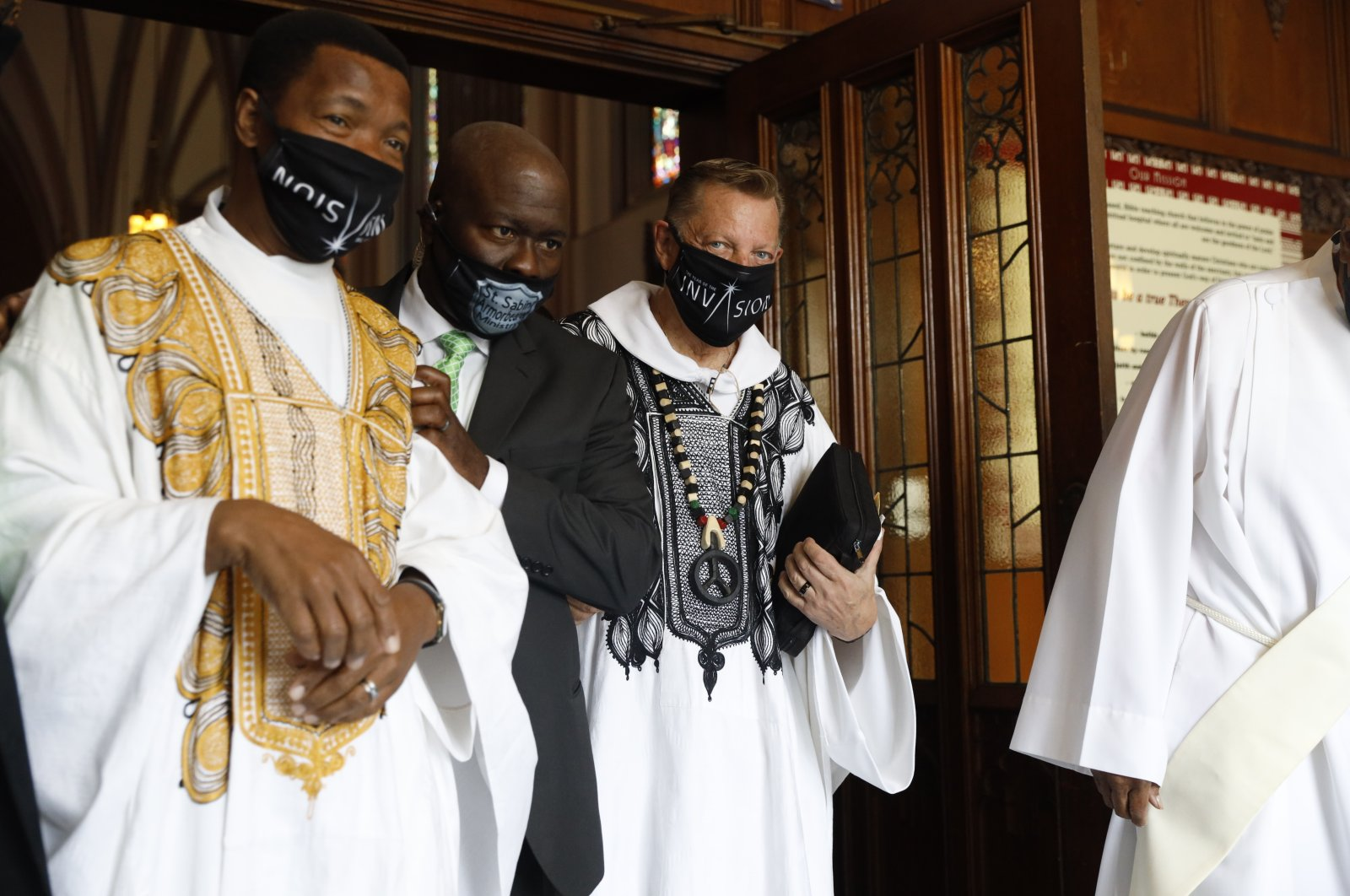 Rev. Michael Pfleger exits the main hall after conducting his first Sunday church service as a senior pastor at St. Sabina Catholic Church following his reinstatement by Archdiocese of Chicago after decades-old sexual abuse allegations against minors, in Chicago, U.S., June 6, 2021. (AP Photo)