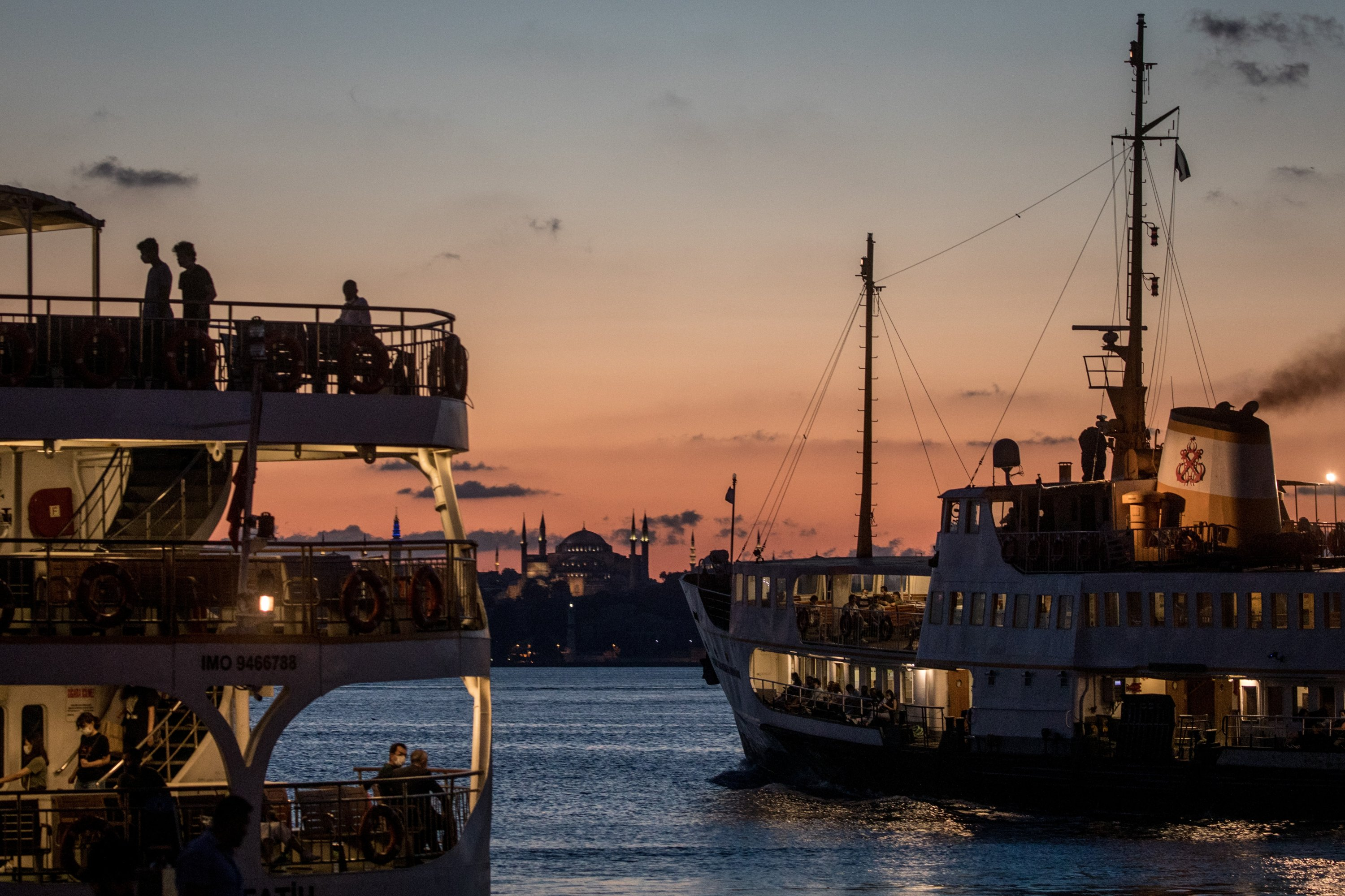 Ferries pass in front of the Hagia Sophia Grand Mosque at sunset, Istanbul, Turkey, Aug. 5, 2020. (Photo by Getty Images)