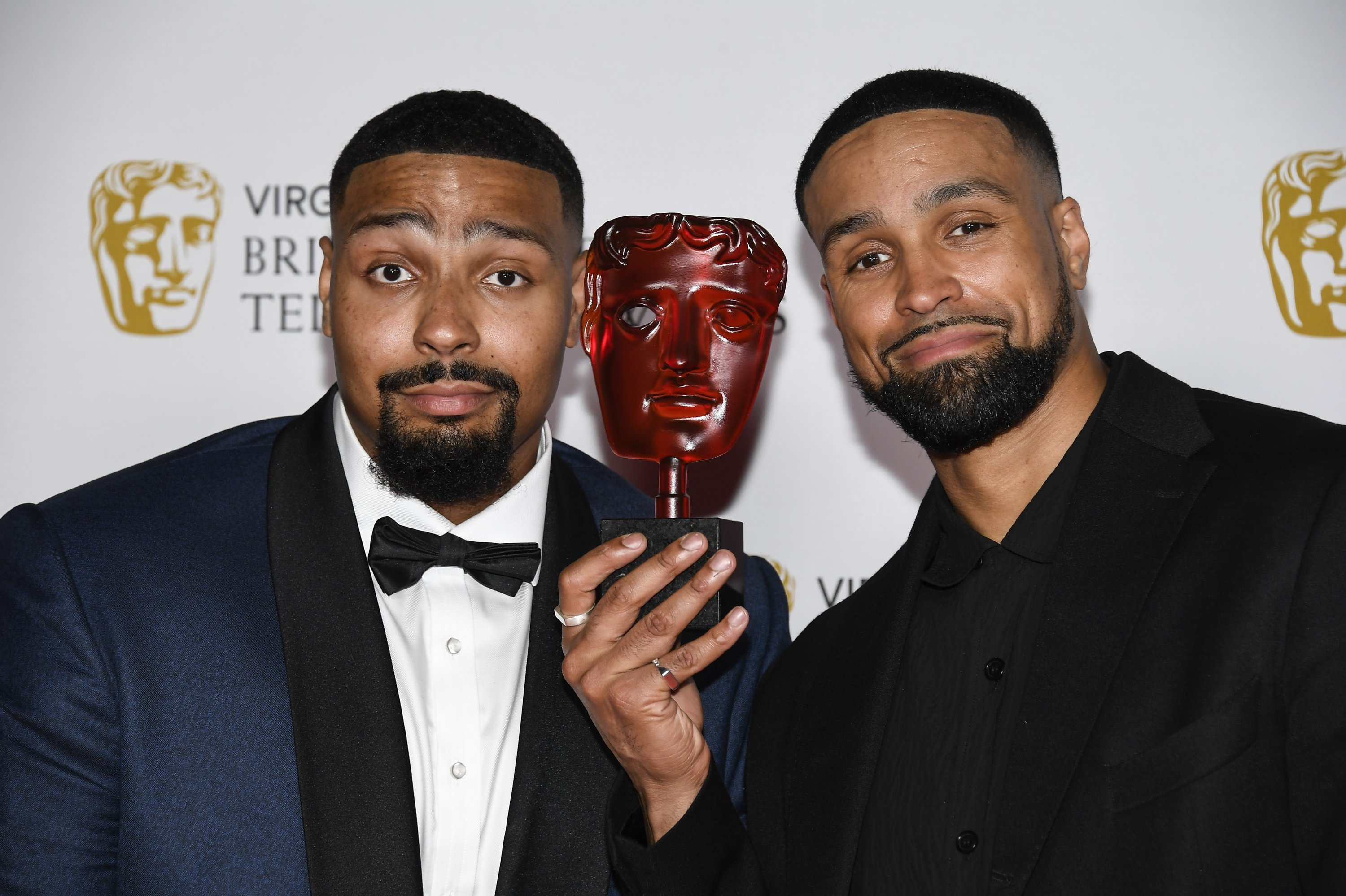 """Jordan Banjo (L) and Ashley Banjo pose with their must-see moment award in """"Britain's Got Talent,"""" backstage at the British Academy Television Awards in London, U.K., June 6, 2021. (AP Photo)"""