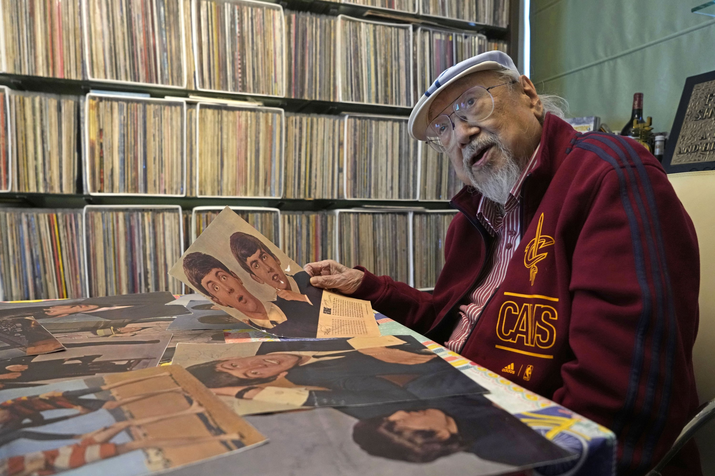 Ray Cordeiro, Hong Kong's oldest DJ shows copies of his Beatles' autographs as the originals are kept with the lawyer, at his home in Hong Kong, May 27, 2021. (AP Photo)