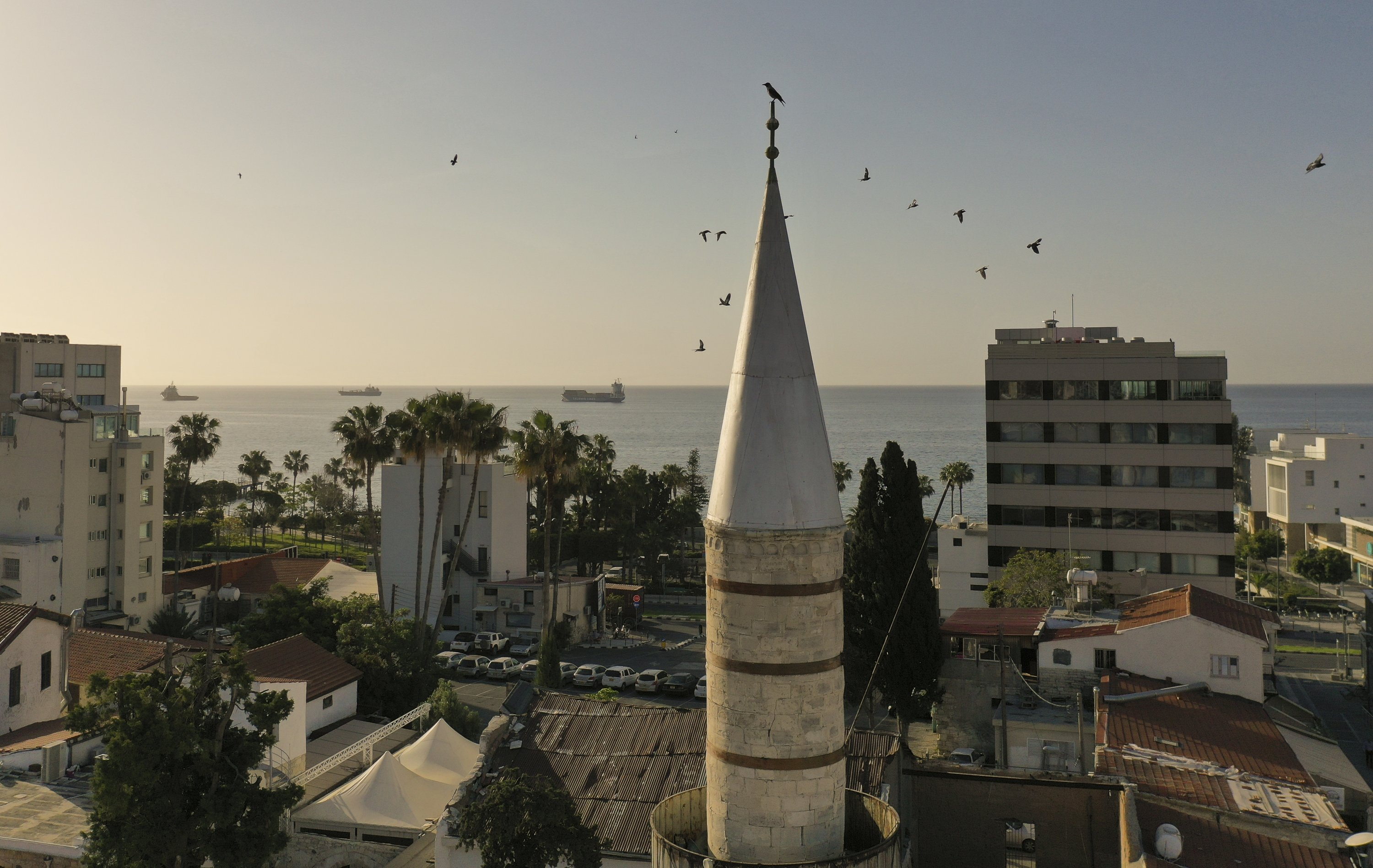 A crow sits on the minaret of the Kebir Mosque, also known as the Grand Mosque of Limassol, overlooking the Mediterranean coast, Limassol, Cyprus, May 5, 2021. (Photo by Getty Images)