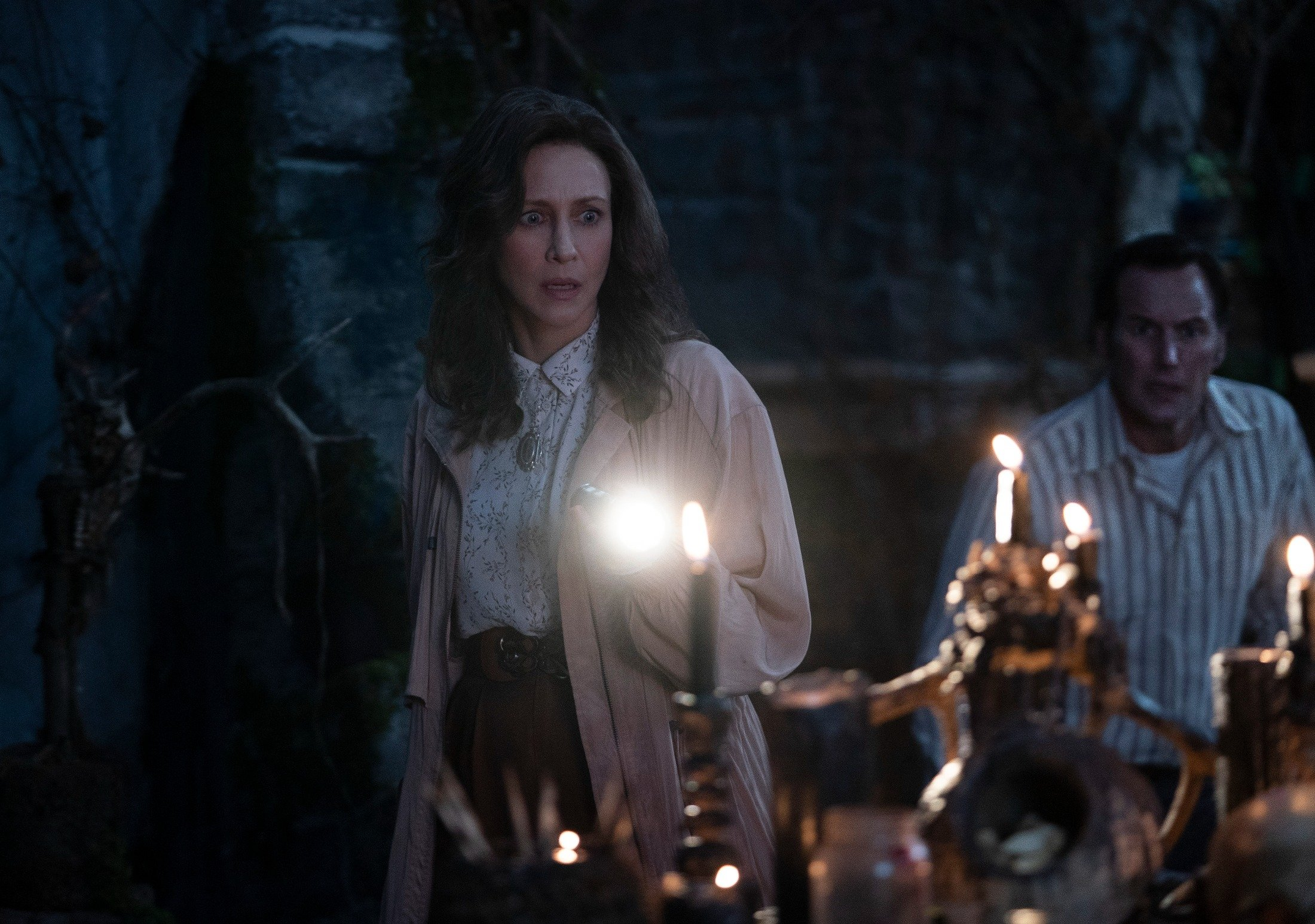 This image released by Warner Bros. Entertainment shows Vera Farmiga (L) and Patrick Wilson in a scene from 'The Conjuring: The Devil Made Me Do It.' (Ben Rothstein/Warner Bros. Entertainment via AP)