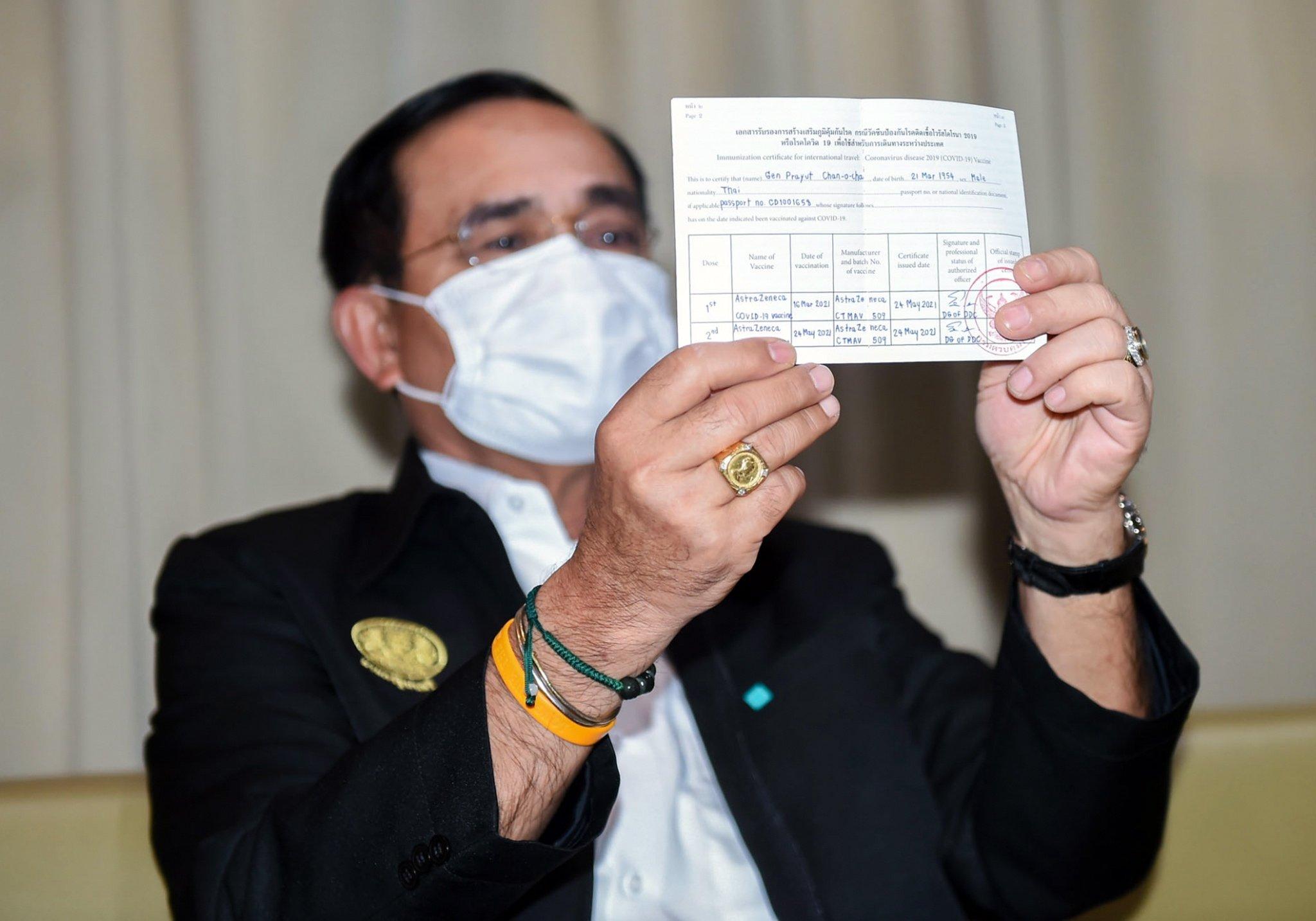 Thai Prime Minister Prayuth Chan-ocha displays his vaccine passport at the Bamrasnaradura Infectious Diseases Institute in Nonthaburi province, Thailand, May 24, 2021. (EPA Photo)