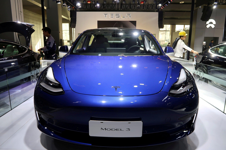 A China-made Tesla Model 3 electric vehicle shines on display at the Guangzhou auto show in Guangzhou, Guangdong province, China,  Nov. 21, 2019. (Reuters Photo)