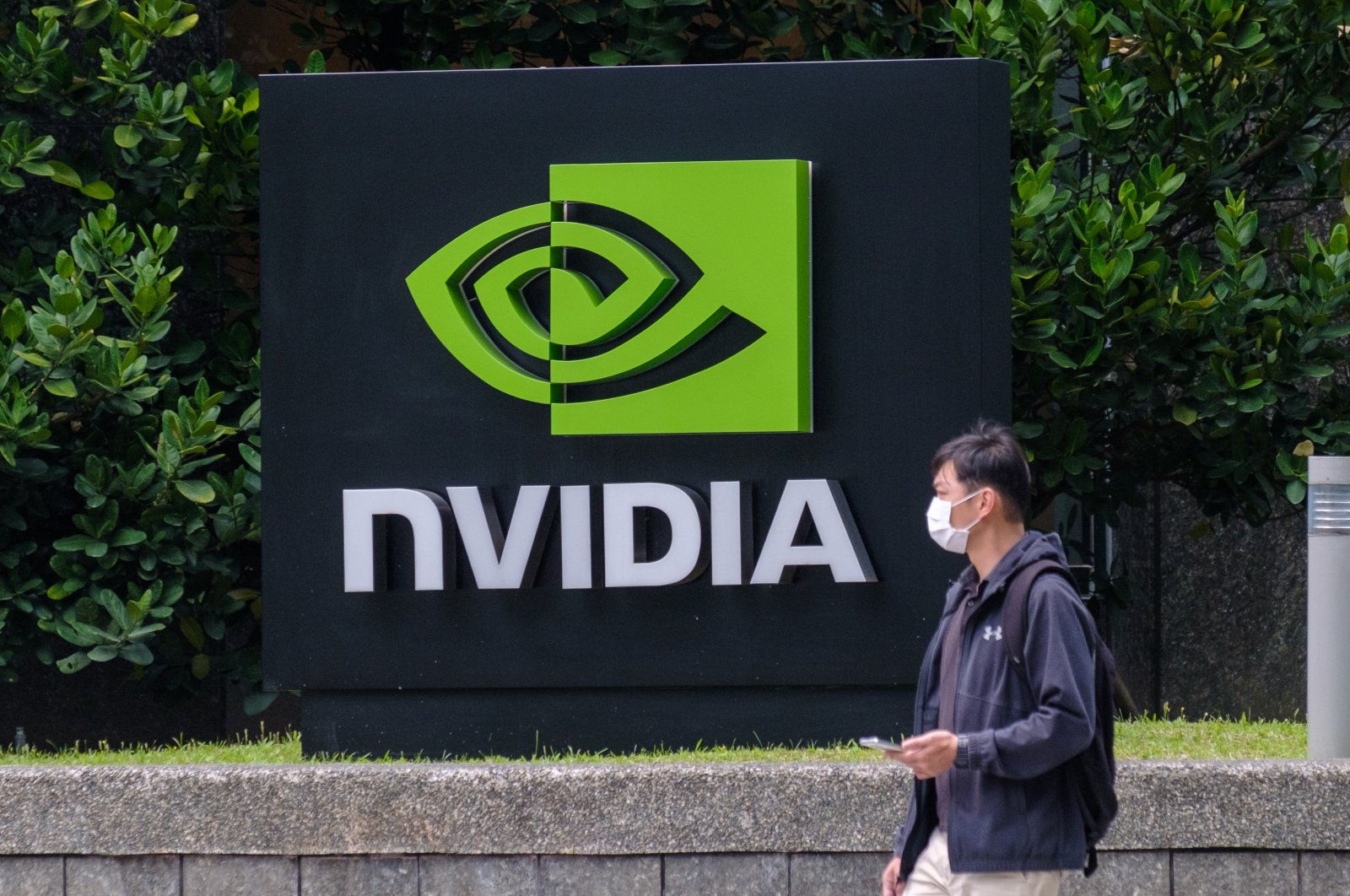 A man is seen passing by the Nvidia logo at the American GPU manufacturer's Taipei office in Taiwan, March 30, 2021. (Reuters Photo)