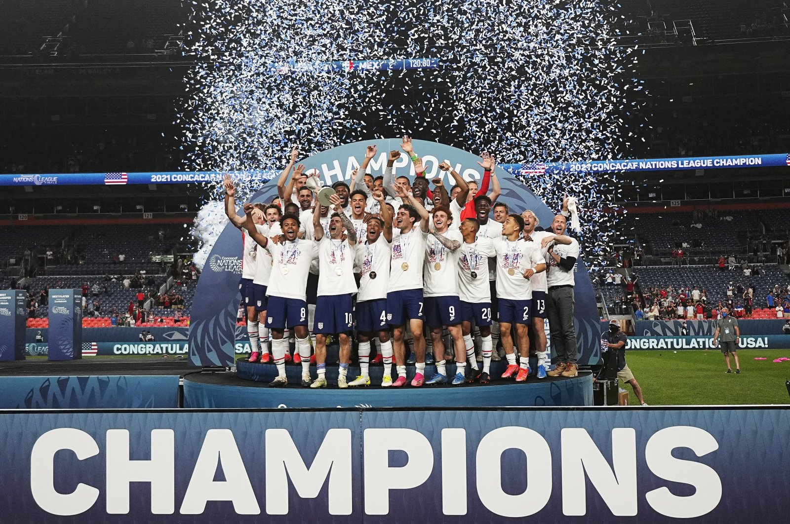 The United States celebrates a 3-2 win against Mexico in extra time in the CONCACAF Nations League championship soccer match, in Denver,  Sunday, June 6, 2021, in Denver. (AP Photo)