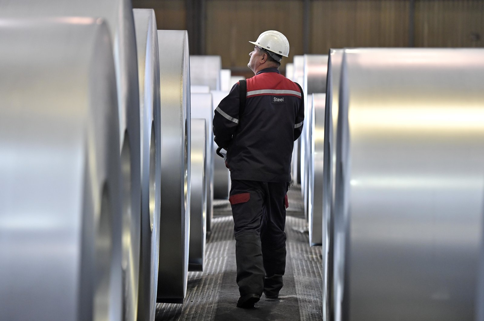 A worker checks steel coils at the ThyssenKrupp steel factory in Duisburg, Germany, April 27, 2018. (AP Photo)