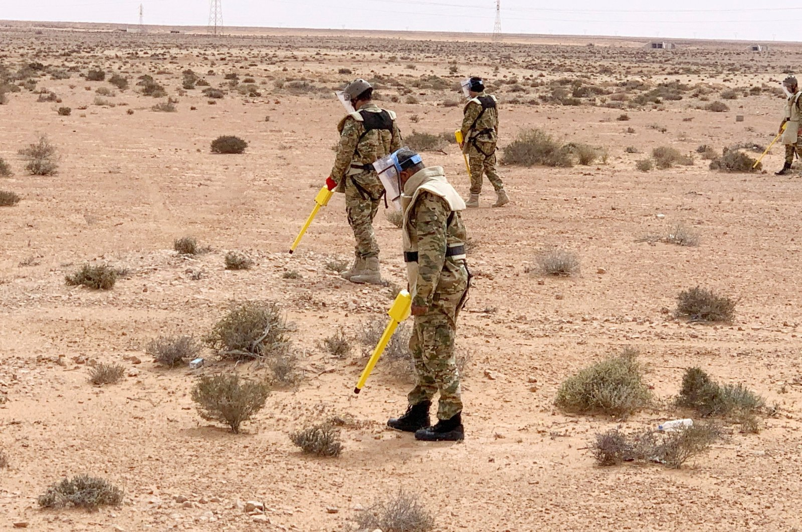 Members of the military engineering team dismantle mines in Abu Grein, Libya, March 13, 2021. (REUTERS Photo)