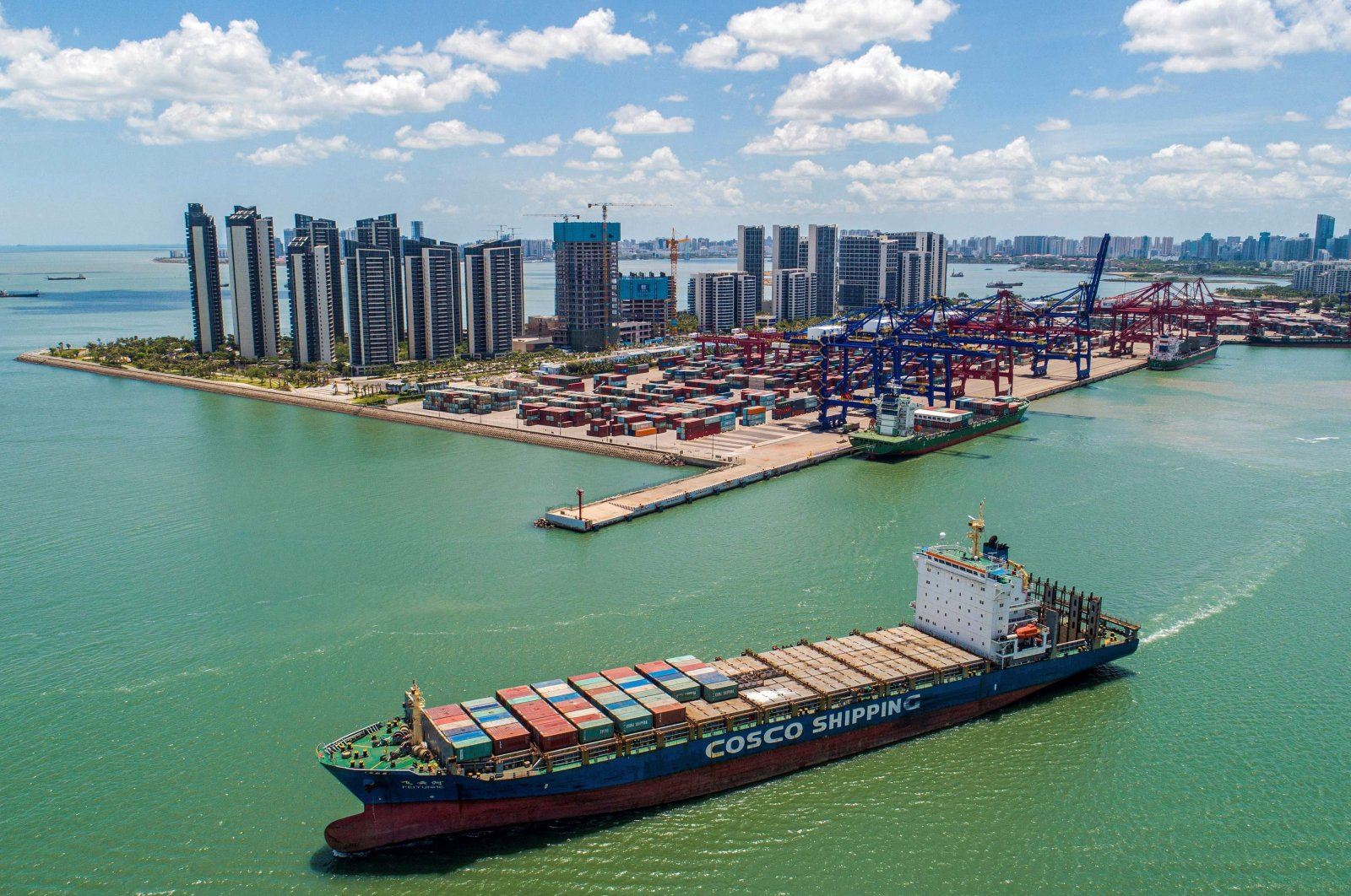 A cargo ship loaded with containers leaves a port in Haikou, Hainan province, southern China, May 17, 2021. (AFP Photo)
