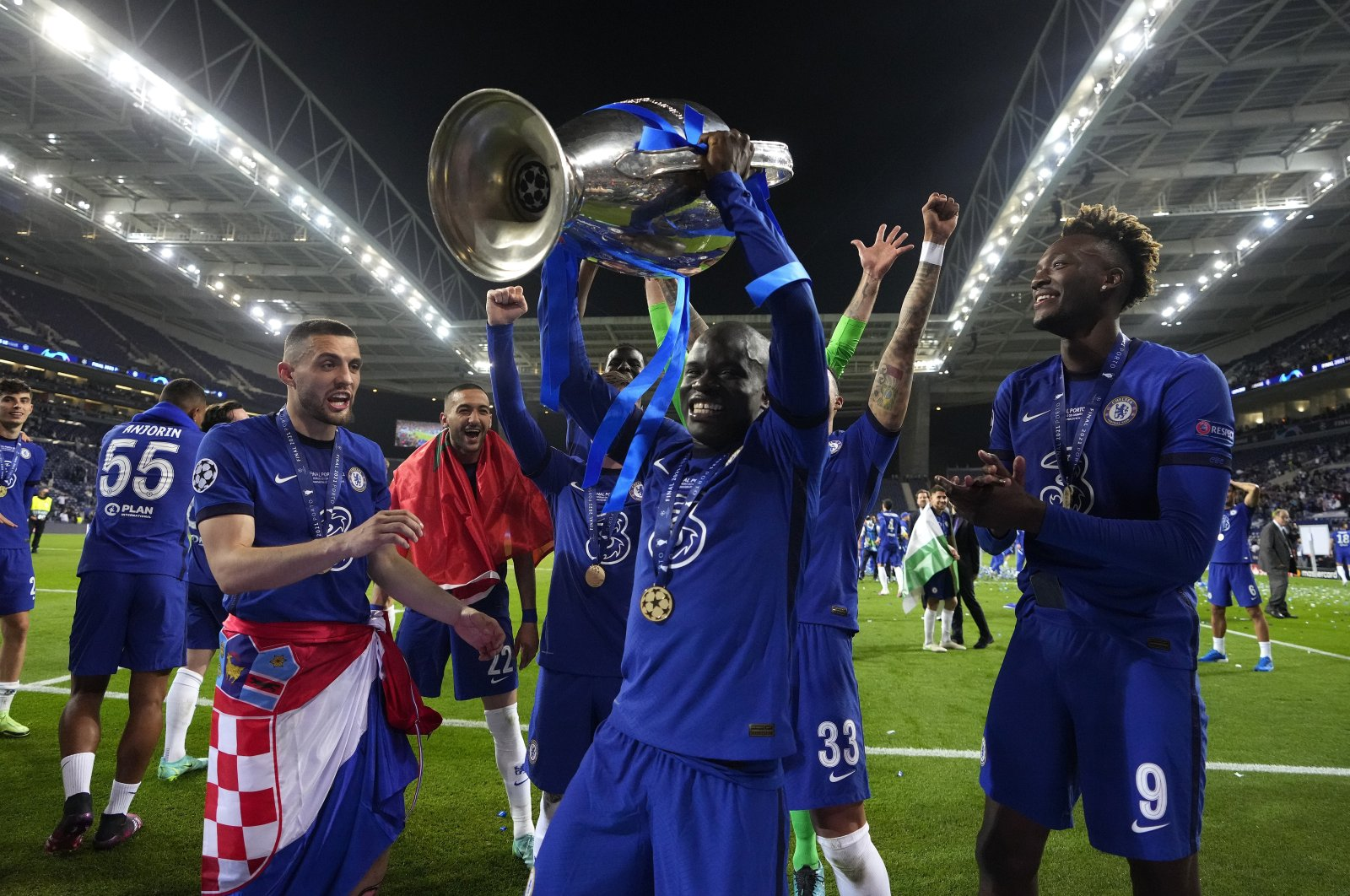 N'Golo Kante of Chelsea celebrates with the Champions League trophy following their team's victory in the UEFA Champions League Final between Manchester City and Chelsea FC at Estadio do Dragao, in Porto, Portugal, May 29, 2021. (Photo by Getty Images)
