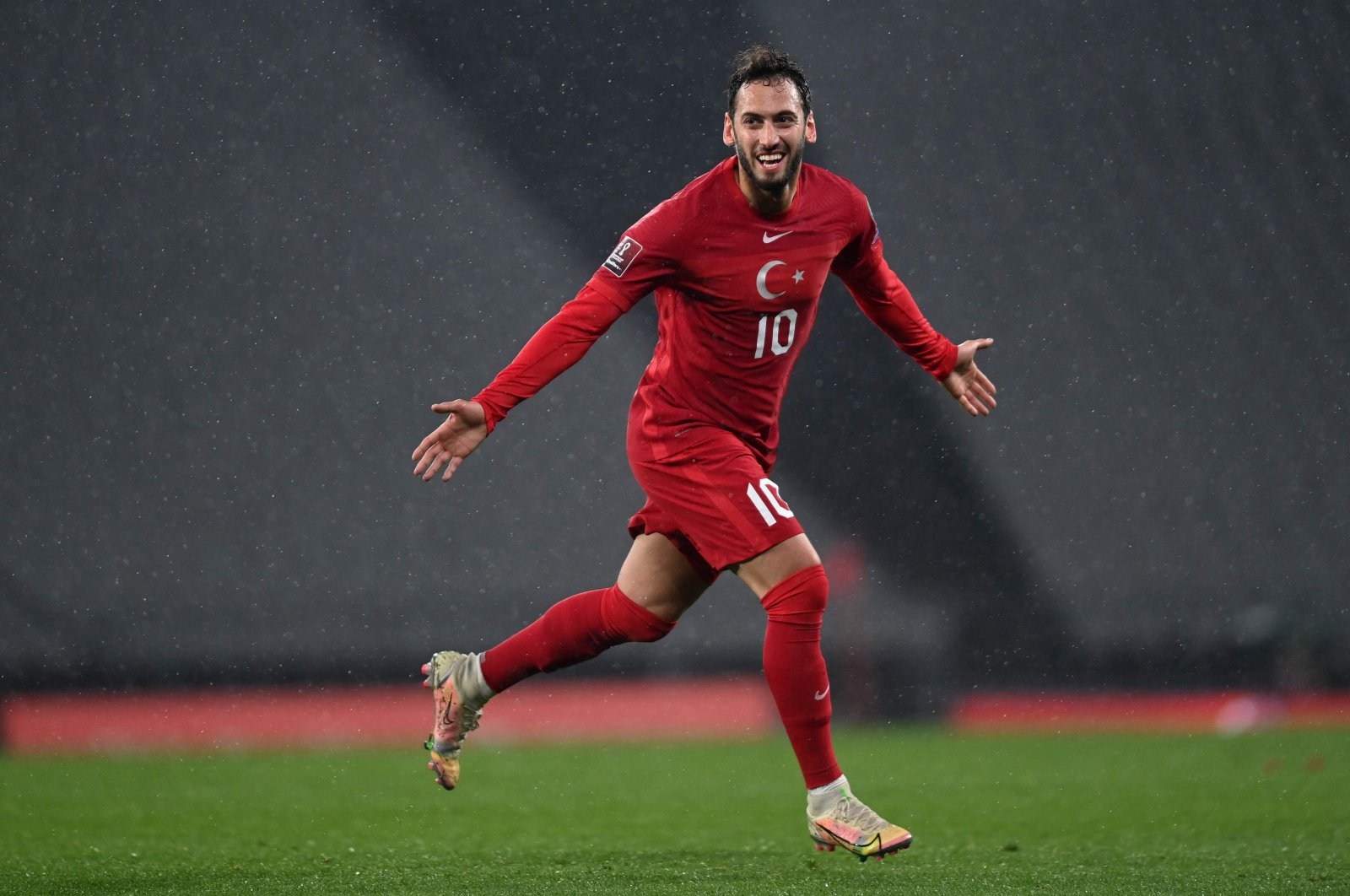 Turkey's Hakan Çalhanoğlu celebrates scoring a goal during the FIFA World Cup Qatar 2022 qualification Group G match against Latvia at the Olympic Stadium, Istanbul, March 30, 2021. (AFP Photo)