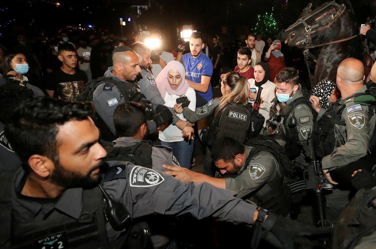 Prominent Palestinian activist Muna al-Kurd reacts during scuffles with Israeli police amid ongoing tension ahead of an upcoming court hearing in an Israeli-Palestinian land-ownership dispute in the Sheikh Jarrah neighborhood of East Jerusalem, occupied Palestine, May 4, 2021. (Reuters Photo)