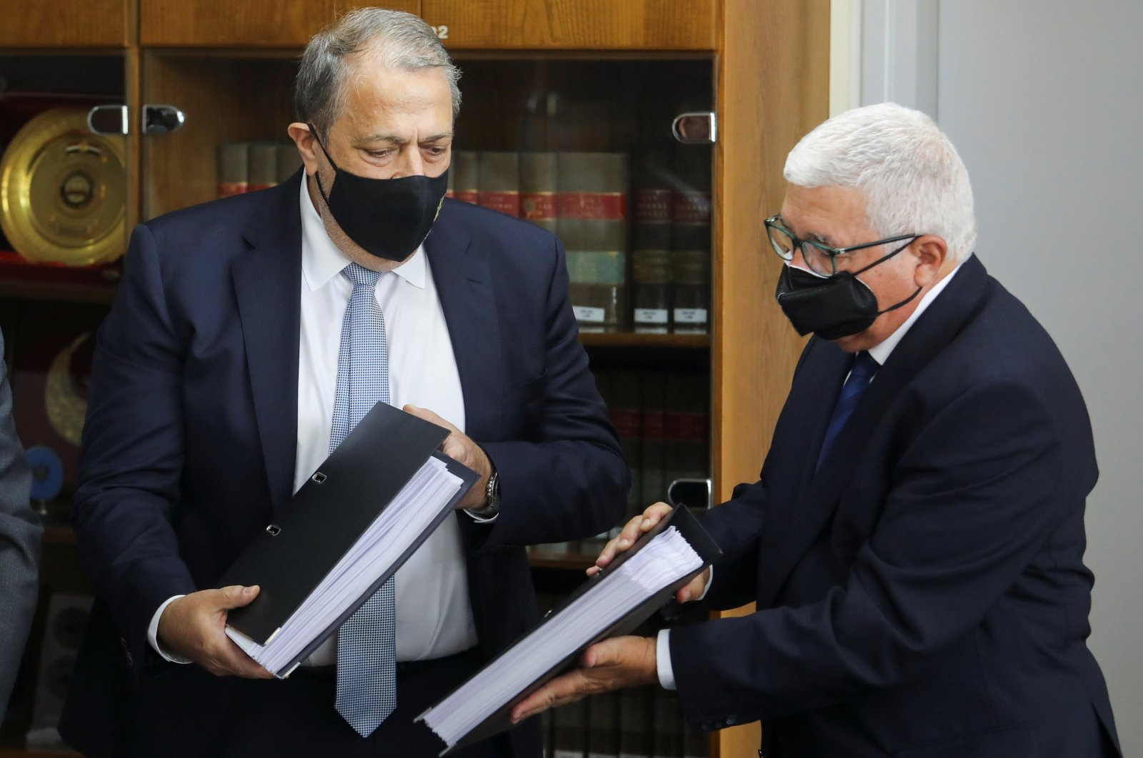 Myron Nicolatos, a former chief justice for the Greek Cypriot administration and head of a commission investigating a discredited cash-for-passports scheme, hands over findings to the country's attorney general Georgios Savvides in Nicosia, Greek Cypriot administration, June 7, 2021. (Reuters Photo)