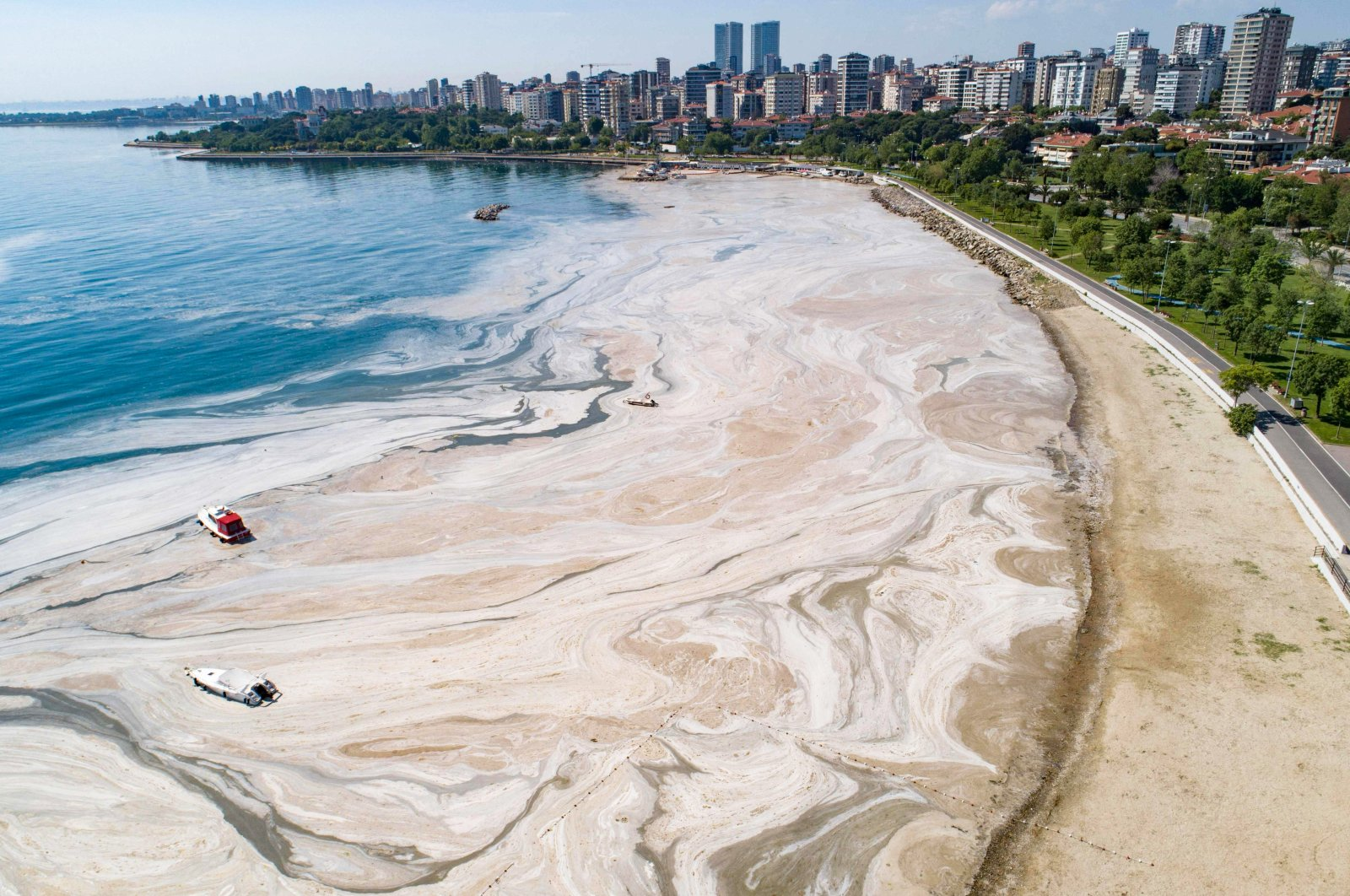 """Mucilage, or """"sea snot,"""" covers the shoreline in Istanbul, Turkey, June 6, 2021. (AFP PHOTO)"""