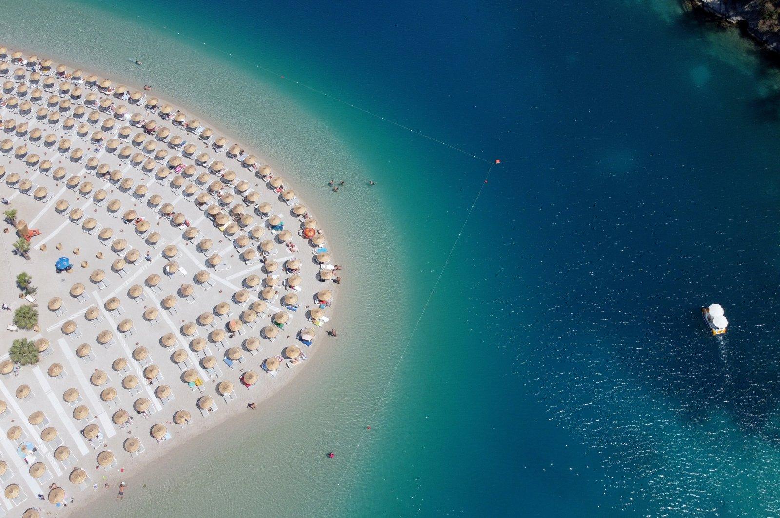 Socially distanced umbrellas dot a beach in Fethiye, Muğla province, southwestern Turkey, June 6, 2021. (AA Photo)