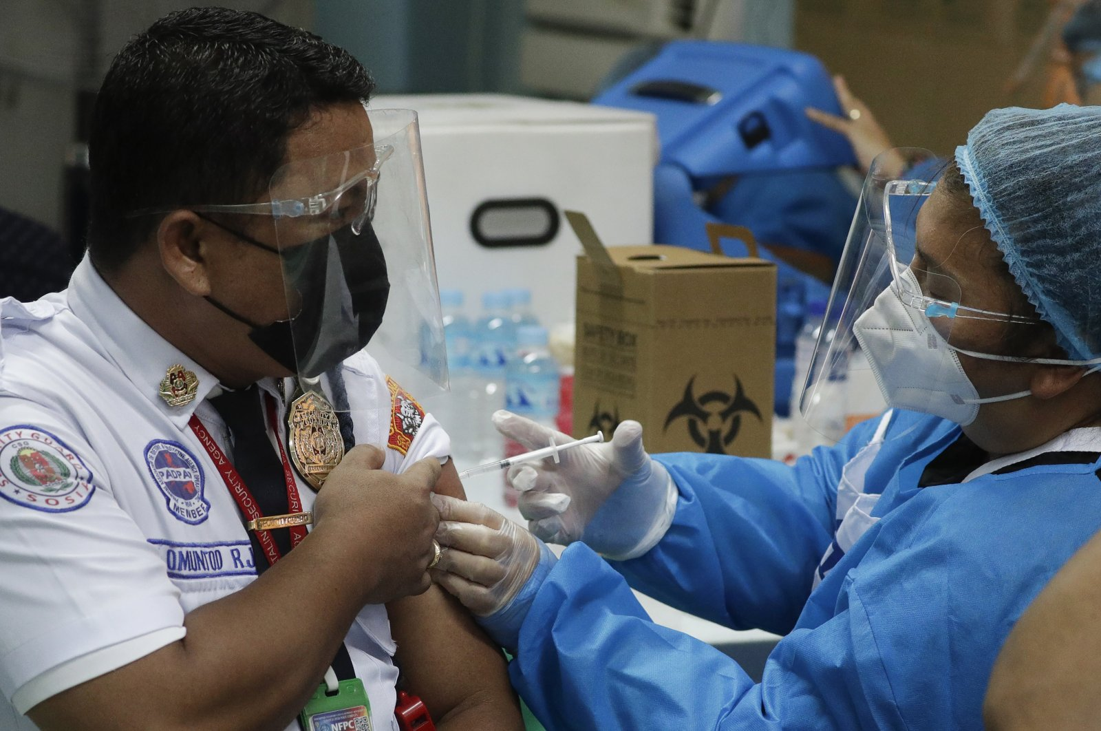 A security guard is inoculated with China's Sinovac COVID-19 vaccine at the Navotas Fish Port, Philippines, June 7, 2021. (AP Photo)