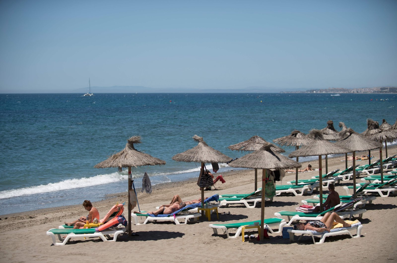Tourists sunbathe at Marbella beach, in Marbella, Spain, June 7, 2021. (AFP)