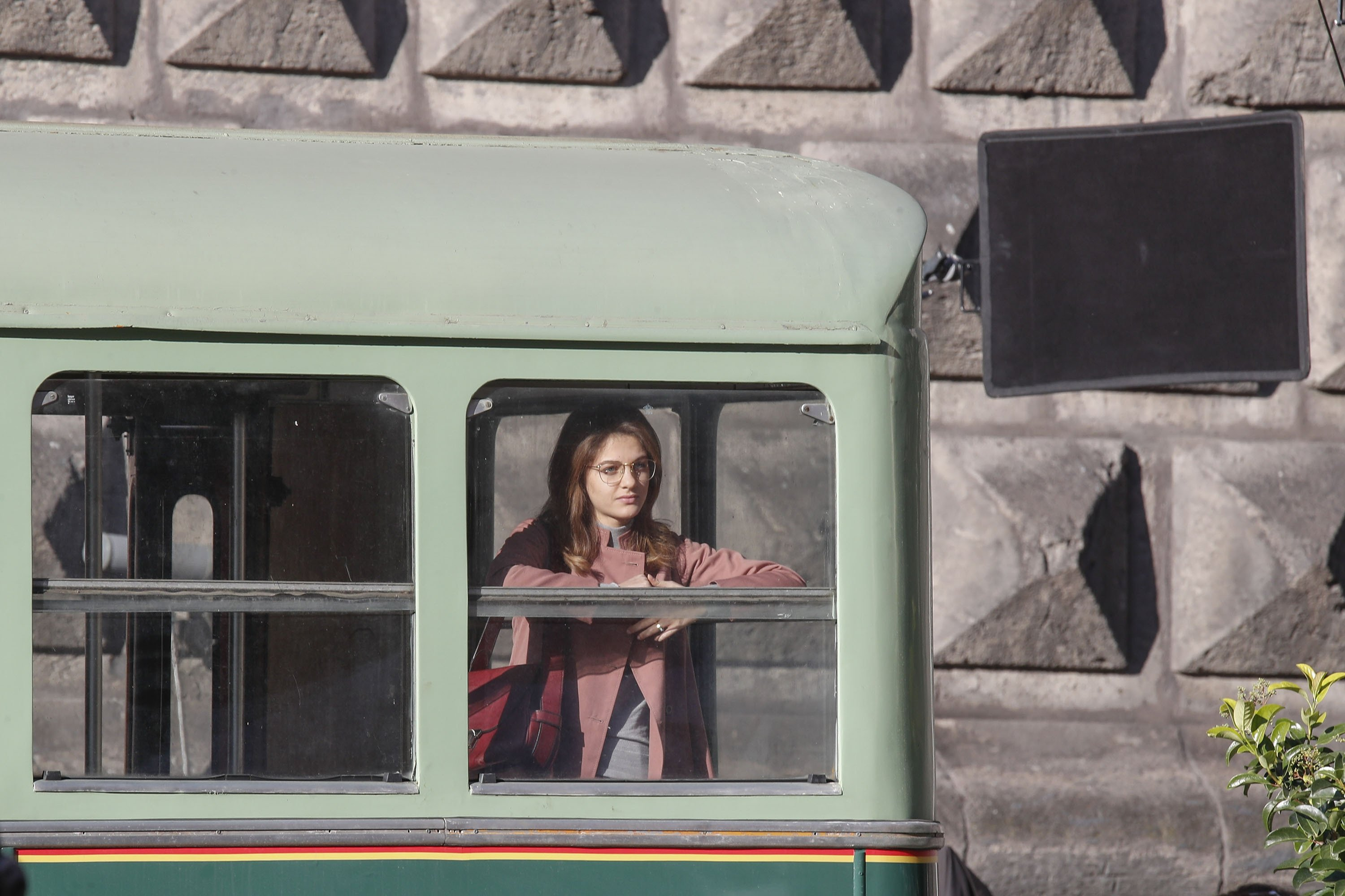 ActressMargherita Mazzucco looks out the window of an old bus on the set of the TV series 'My Brilliant Friend' ('L'amica geniale') based on the novels of Elena Ferrante, in Naples, Italy, Jan. 13, 2021. (Getty Images)