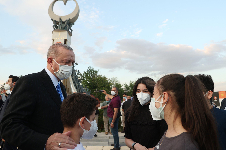 President Recep Tayyip Erdoğan talks with teens in front of the July 15 Martyrs' Monument, Ankara, Turkey, June 7, 2021. (AA Photo)