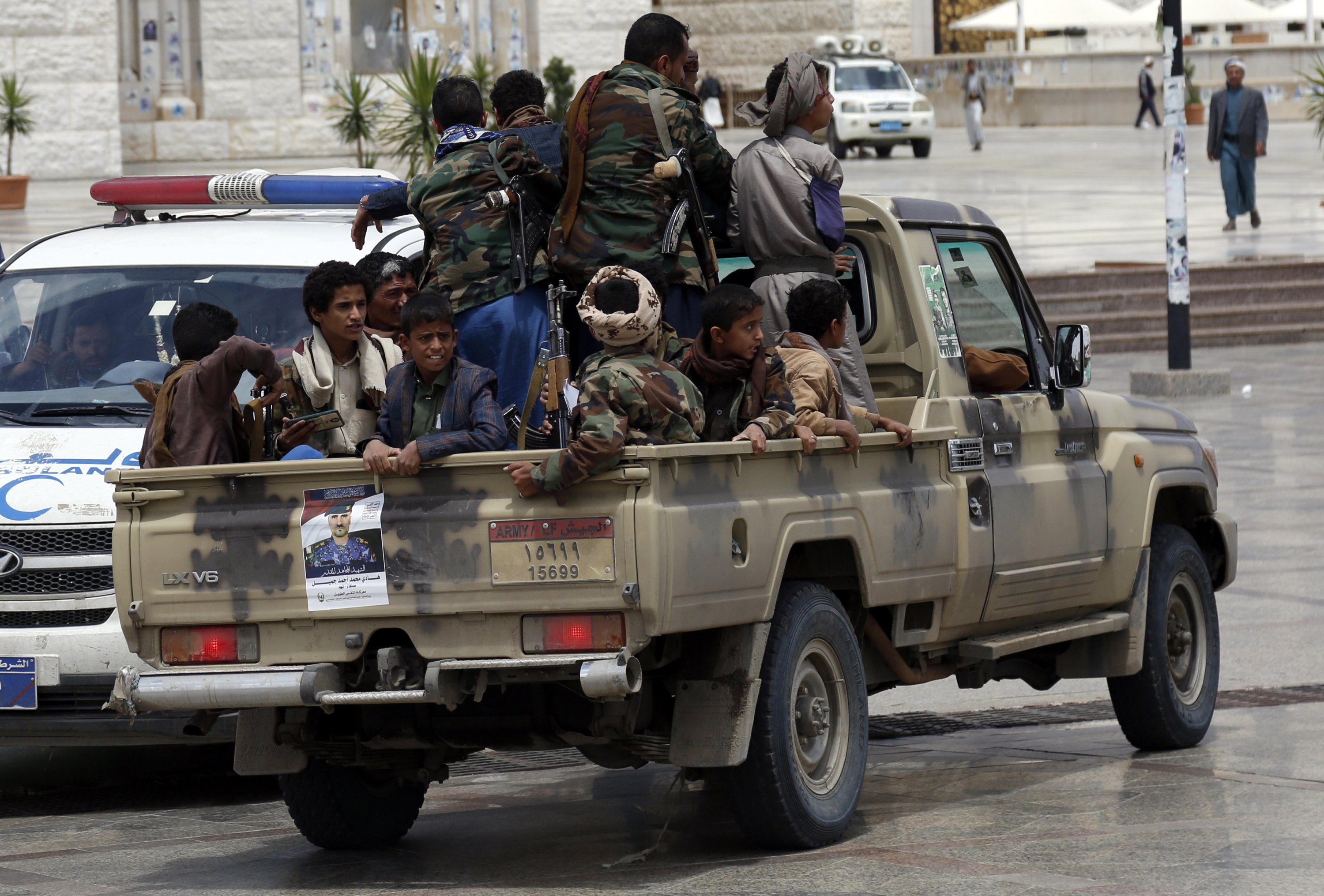 Houthi followers ride on a truck during a funeral in Sanaa, Yemen, May 2, 2021. (Photo by Getty Images)