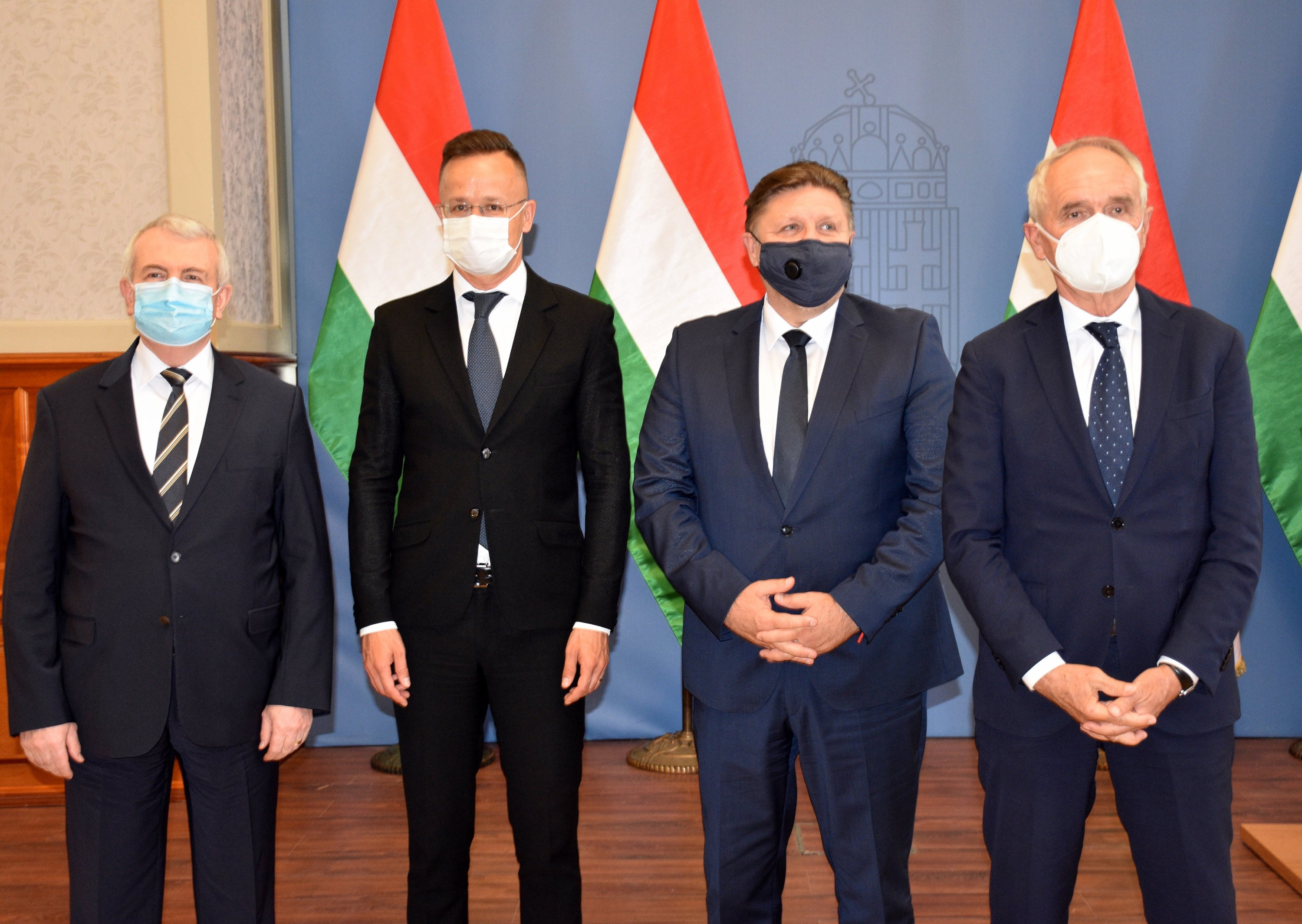 Hungarian Minister of Foreign Affairs and Foreign Trade Peter Szijjarto (2nd L) and Turkish Ambassador to Budapest Ahmet Akif Oktay (L) attend a ceremony held for the opening of the Şişecam factory in the country, Budapest, Hungary, June 7, 2021. (AA Photo)