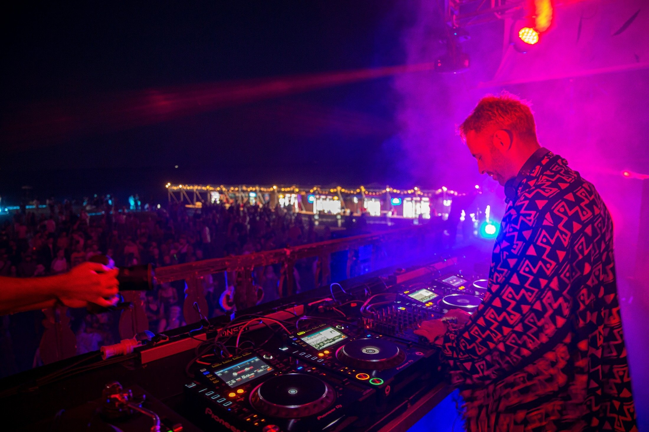 Gentian Riza local DJ performs in front of thousands of international fans at Unum Albania's open-air music festival in Shengjin, Albania, June 4, 2021. (AP Photo)