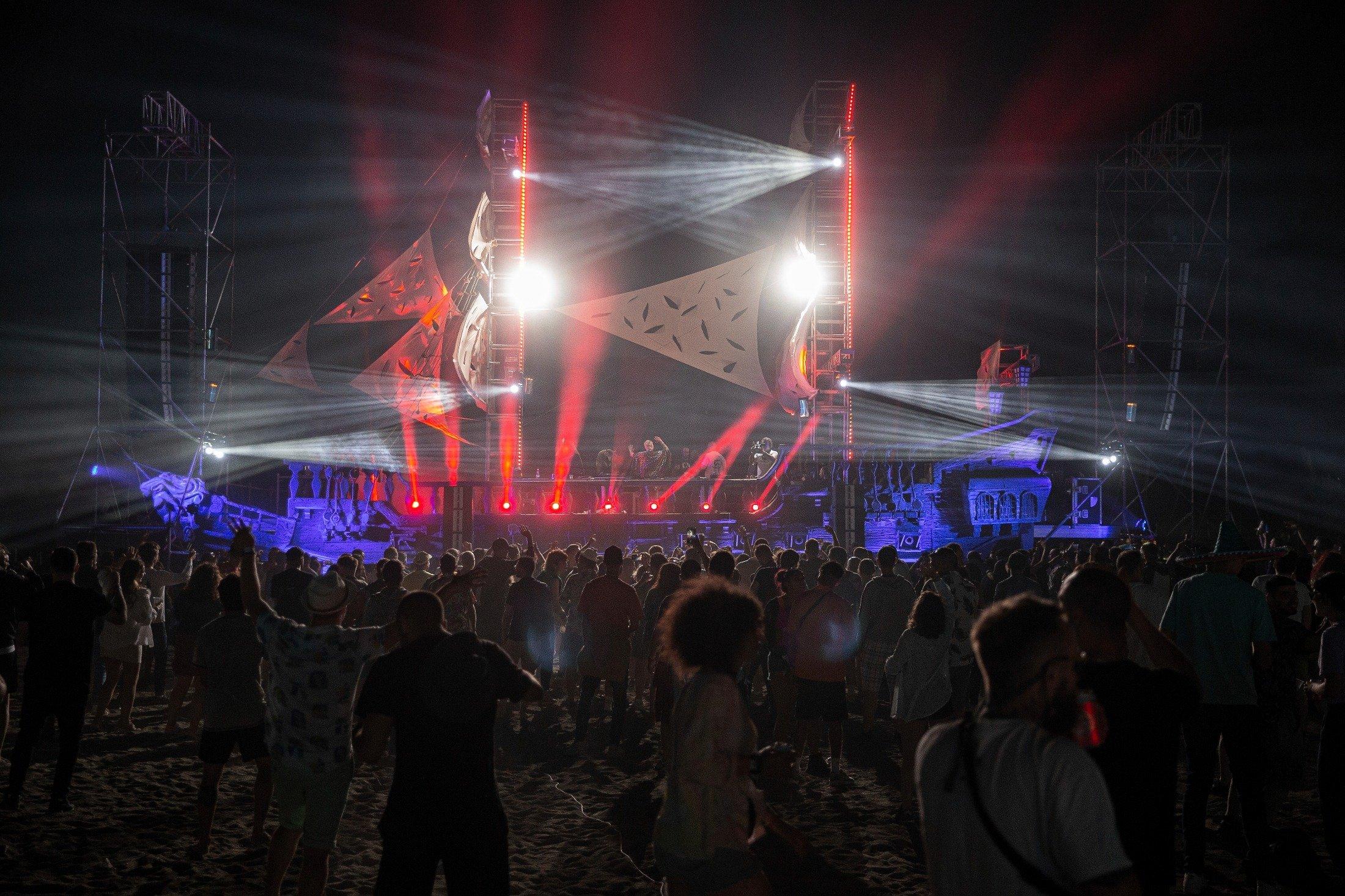 Thousands of virus-free international fans participate at Unum Albania's open-air music festival in Shengjin, Albania, June 4, 2021. (AP Photo)