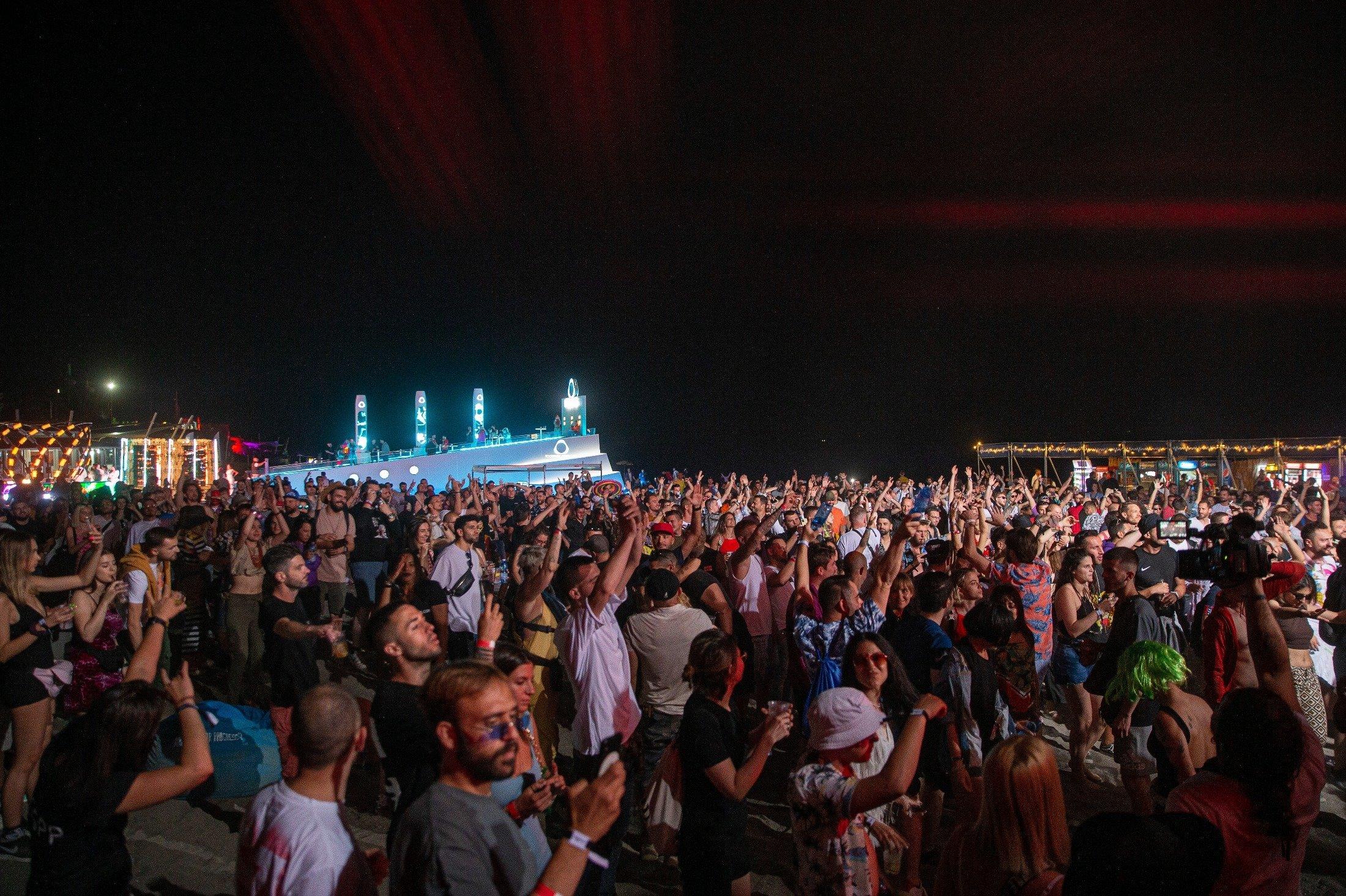 Thousands of coronavirus-free international fans participate at Unum Albania's open-air music festival in Shengjin, Albania, June 4, 2021. (AP Photo)