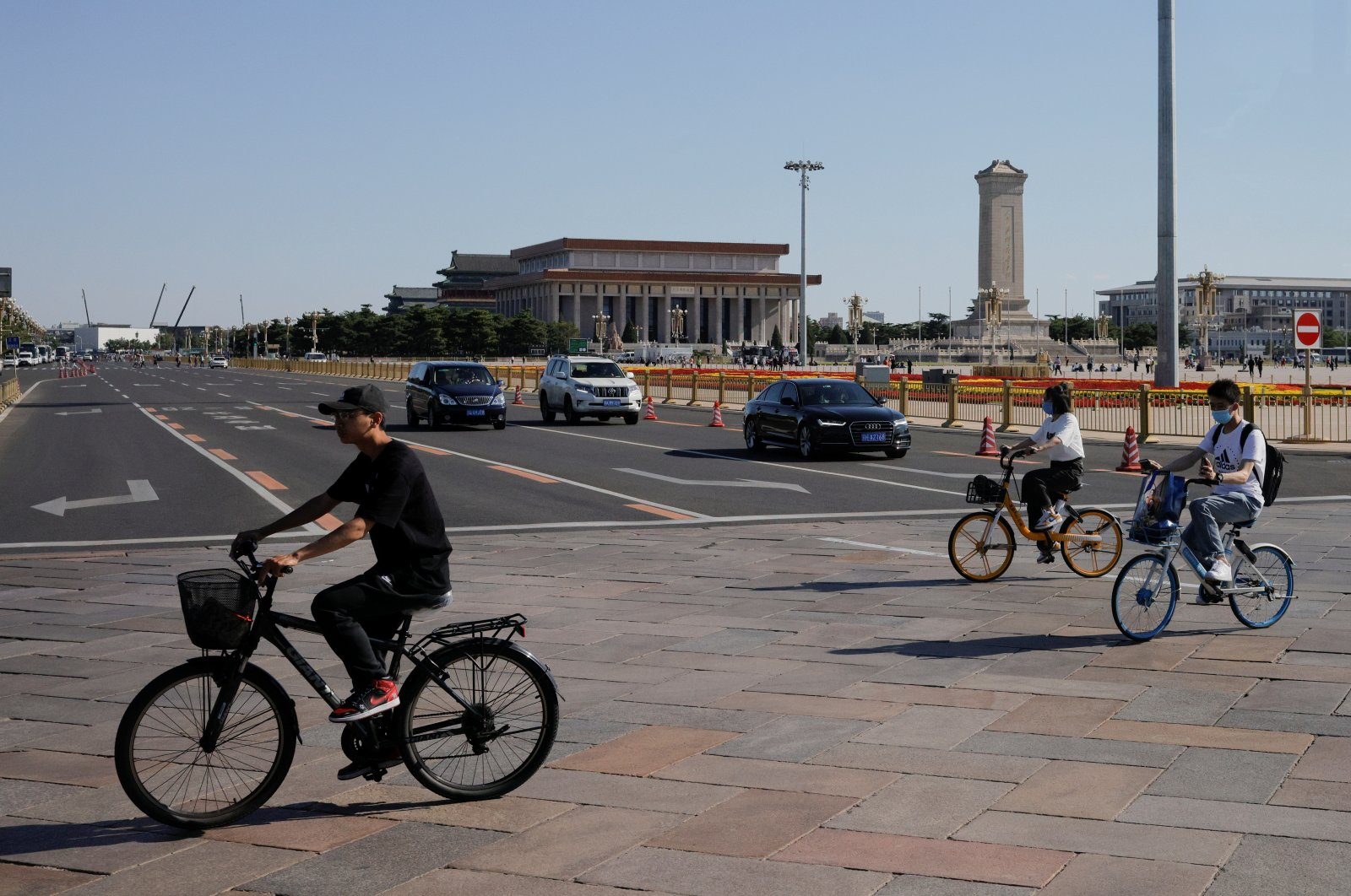 Cyclists cross Tiananmen Square in Beijing, China, June 3, 2021. (Reuters Photo)