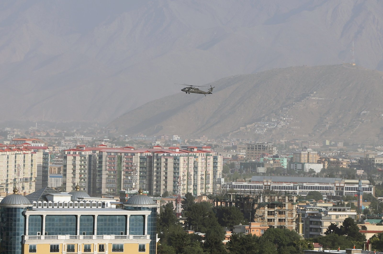 A NATO helicopter flies over the city of Kabul, Afghanistan, June 29, 2020. (REUTERS Photo)
