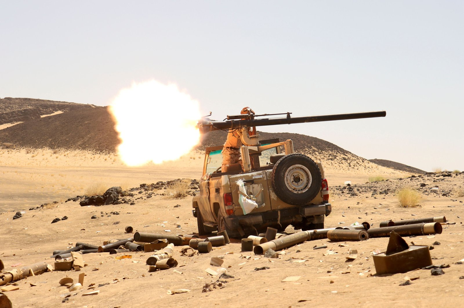 A Yemeni government fighter fires a vehicle-mounted weapon at a frontline position during fighting against Houthi fighters in Marib, Yemen, March 9, 2021. (Reuters Photo)