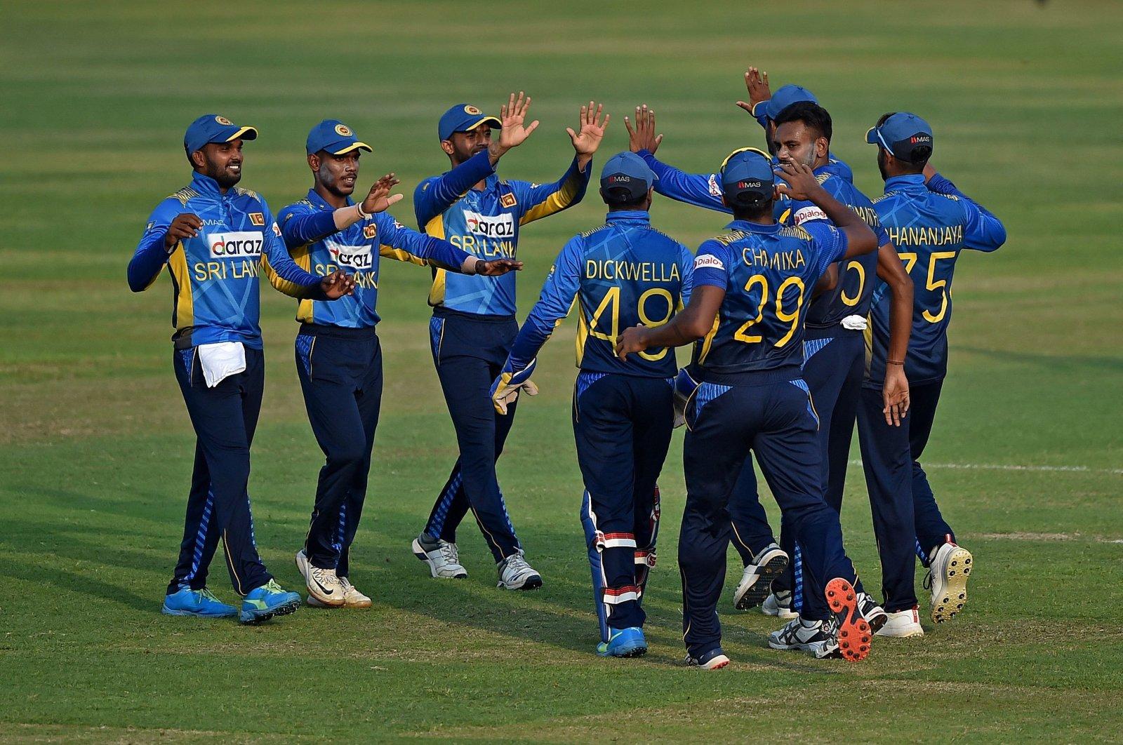 Sri Lankan cricketers celebrate the dismissal of Bangladesh's Naim Sheikh (not pictured) during the third and final One Day International (ODI) match at Sher-e-Bangla National Cricket Stadium, Dhaka, Bangladesh, May 28, 2021. (AFP Photo)