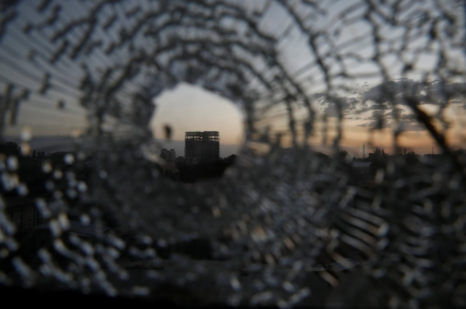 A building is seen through a bullet hole in a window of the Africa Hotel in the town of Shire, Tigray region, Ethiopia, March 16, 2021. (Reuters Photo)