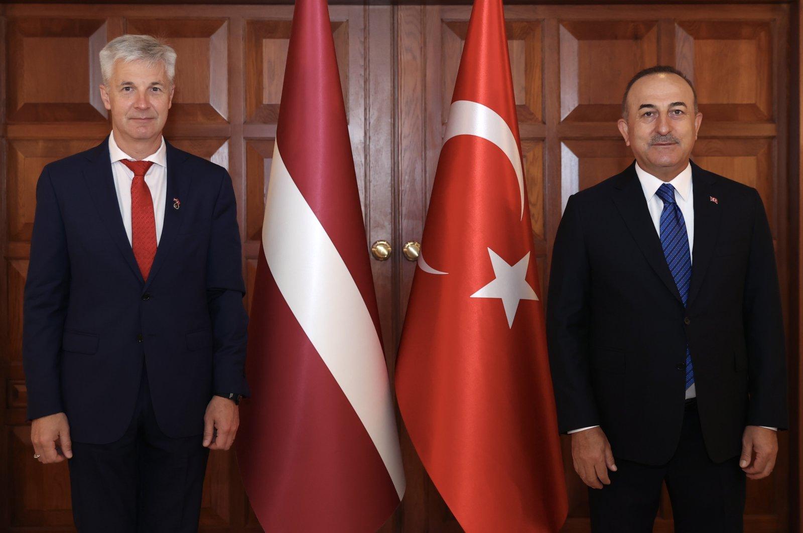 Turkish Foreign Minister Mevlüt Çavuşoğlu (R) receives Latvia's Deputy Prime Minister Artis Pabriks in the capital, Ankara, Turkey, June 8, 2021. (AA Photo)