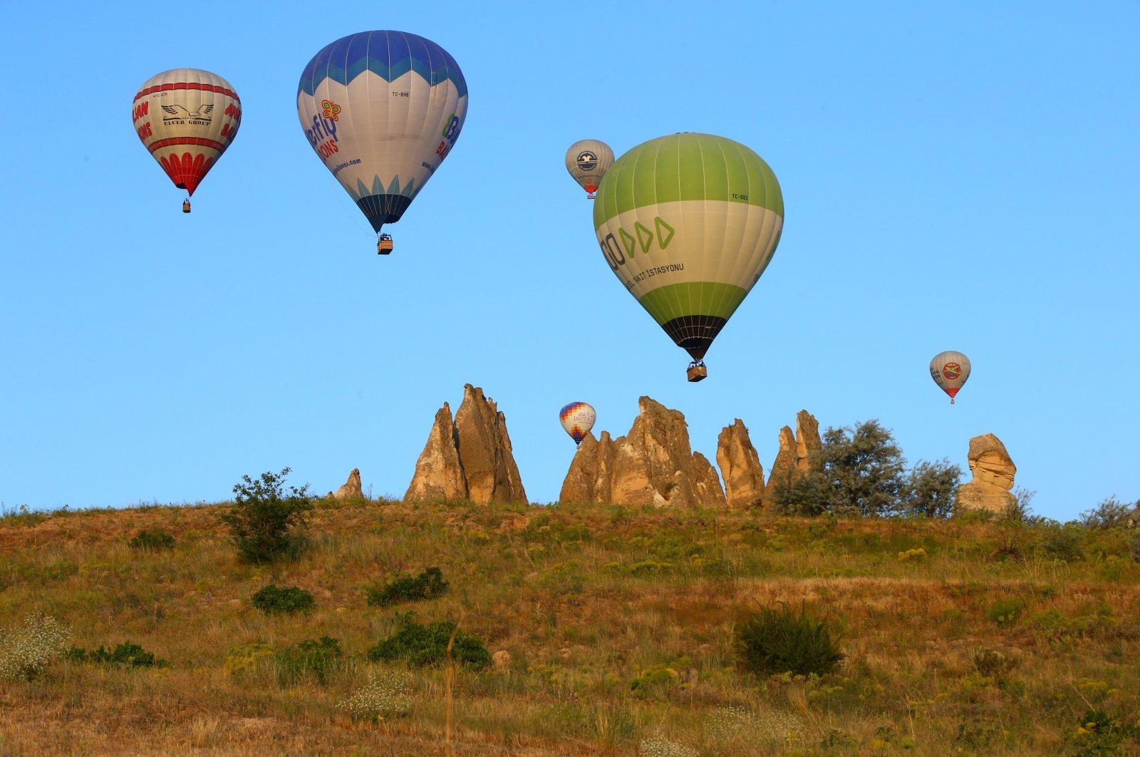 Hot air balloons take off in the touristic Cappadocia region, Nevşehir, central Turkey, June 8, 2021. (AA Photo)