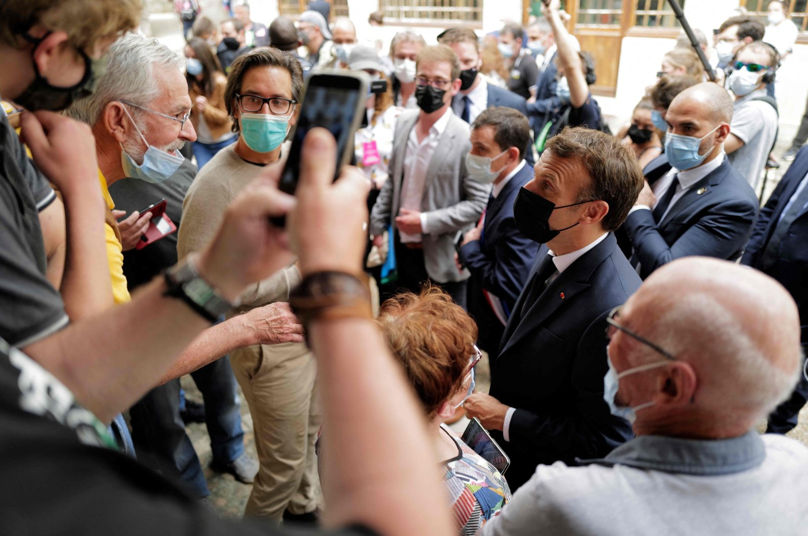 French President Emmanuel Macron meets people in Martel during a two-day visit in southern France, June 3, 2021. (AFP Photo)
