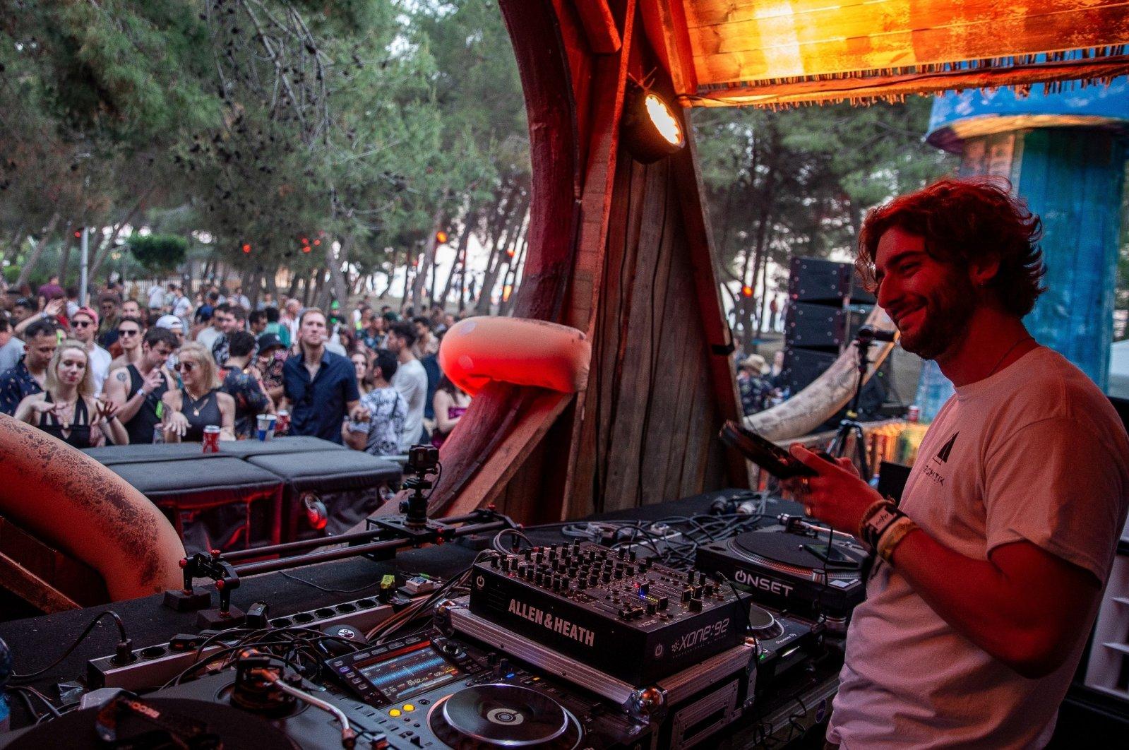 Rron Kurtolli Chicago,Ilinois based DJ performs in front of thousands of international fans at Unum Albania's open-air music festival in Shengjin, Albania, June 4, 2021. (AP Photo)