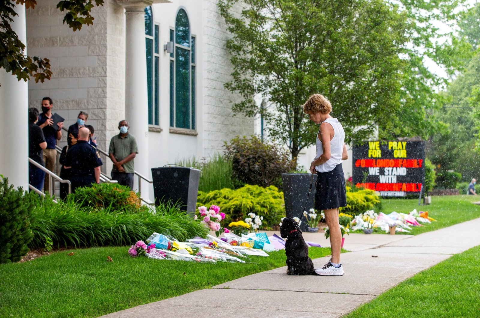 A woman pays her respects at the London Muslim Mosque, which is located about 500 meters from where police arrested the suspect of a hate-motivated Islamophobic terror attack that killed four members of a Muslim family, in London, Ontario, Canada, June 8, 2021. (Reuters Photo)