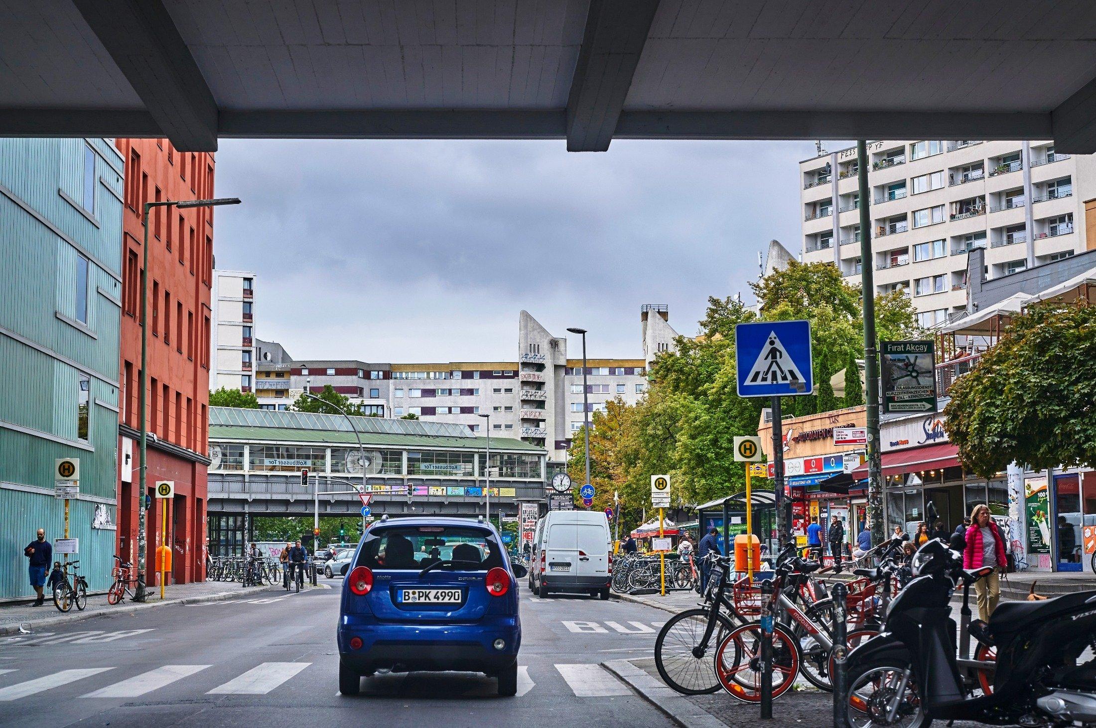 A car passes under the Kottbusser Tor train station in the Kreuzberg district of Berlin, Germany, Sept. 16, 2019. (Shutterstock Photo)