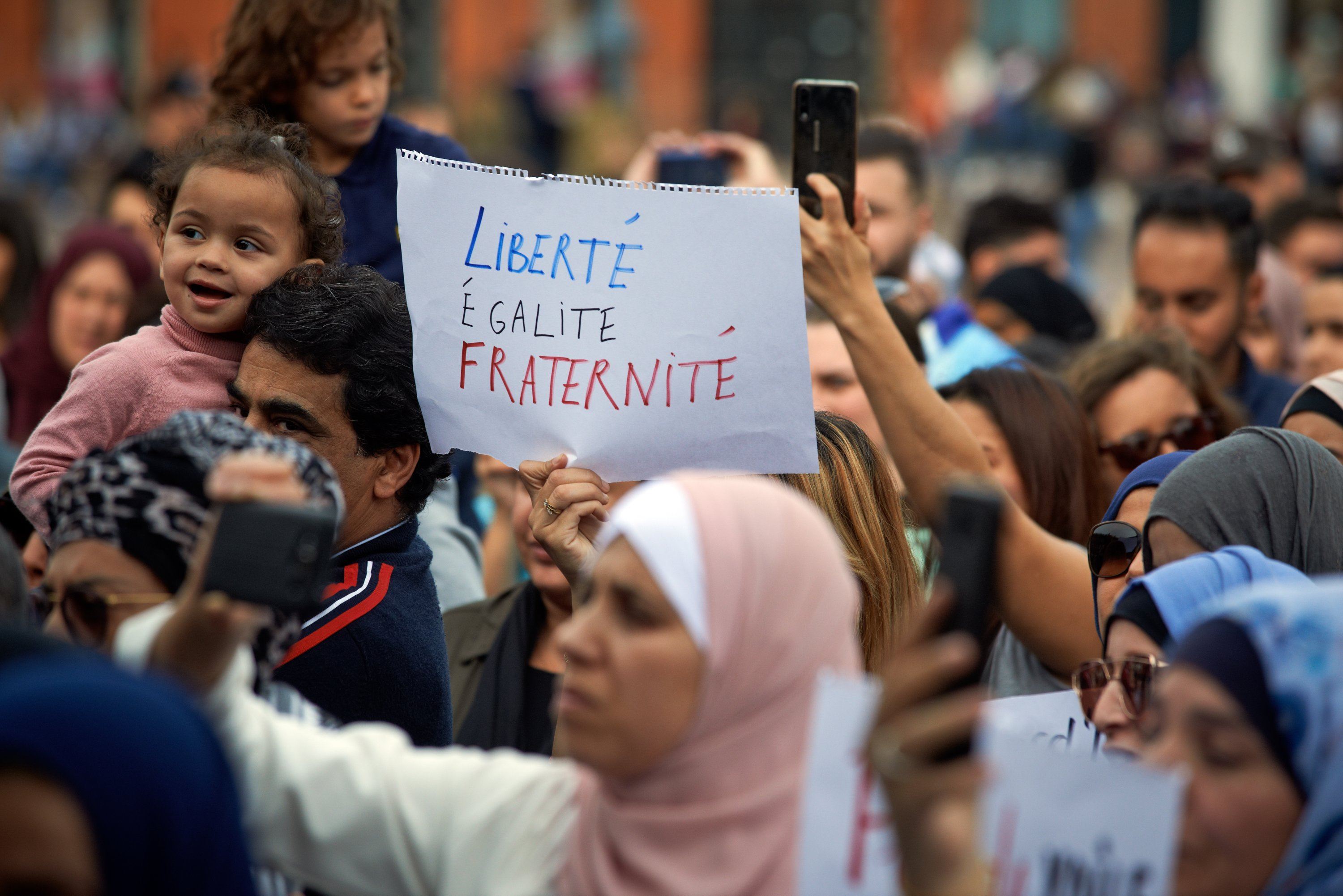 A protestor holds a placard reading 'Liberty, Equality, Fraternity' during a demonstration against Islamophobia on the main square of Toulouse, France, Oct. 27, 2019. (Photo by Getty Images)