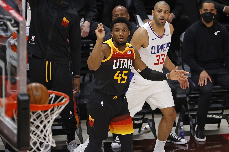 Utah Jazz guard Donovan Mitchell (L) watches his 3-pointer drop against LA Clippers forward Nicolas Batum (R) during Game 1 of their second-round NBA Playoffs series, at Vivint Arena, Salt Lake City, Utah, U.S.,Jun 8, 2021. (Reuters Photo)
