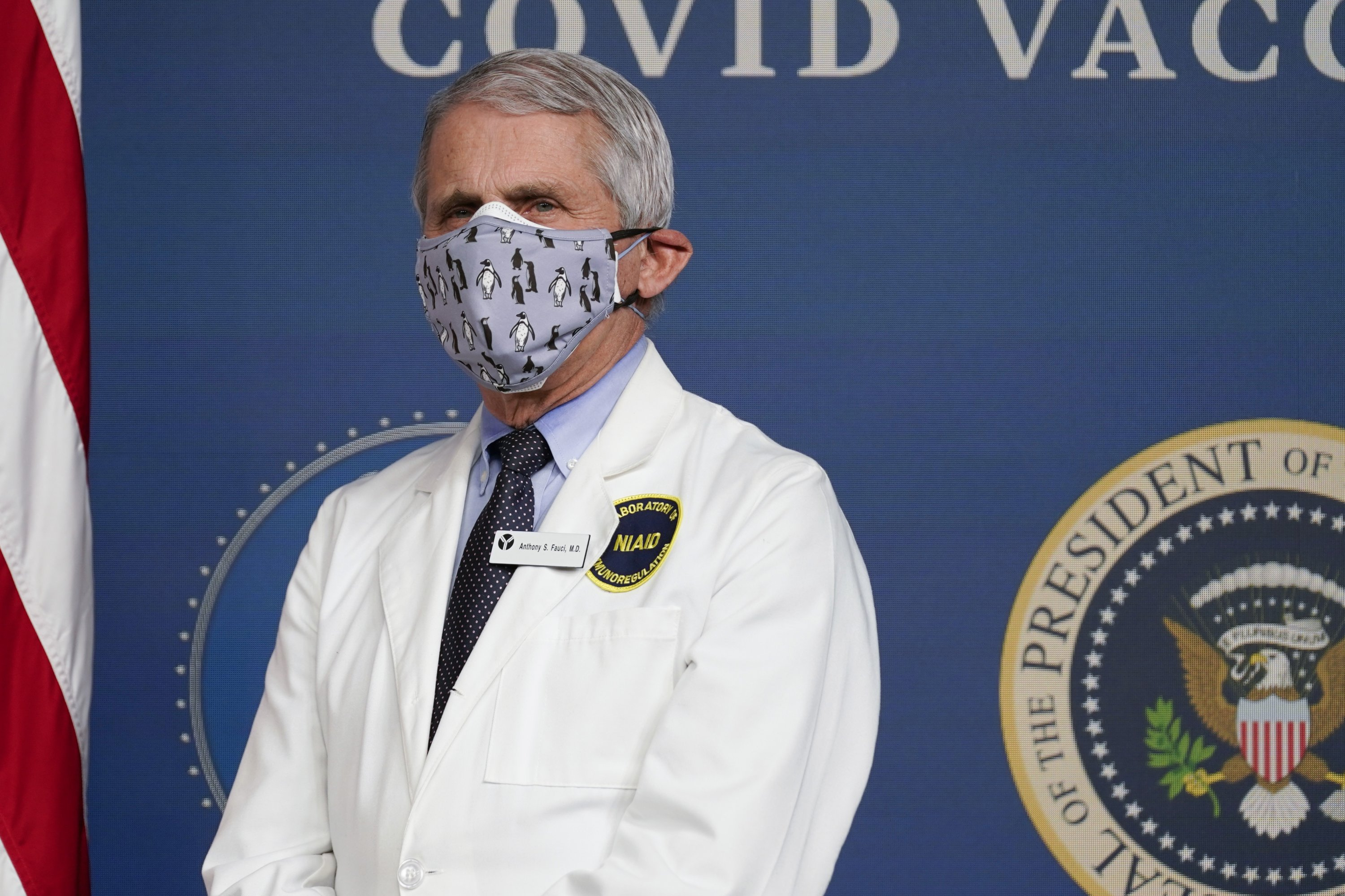 Dr. Anthony Fauci, director of the National Institute of Allergy and Infectious Diseases, listens as U.S. President Joe Biden speaks during an event to commemorate the 50 millionth COVID-19 shot in Washington, U.S., Feb. 25, 2021. (AP Photo)