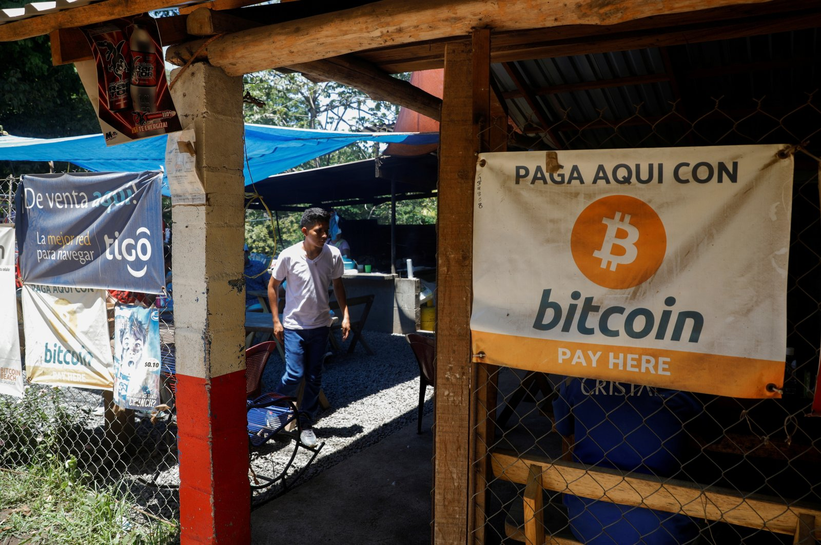 Bitcoin banners are seen outside a small restaurant at El Zonte Beach in Chiltiupan, El Salvador, June 8, 2021. (Reuters Photo)