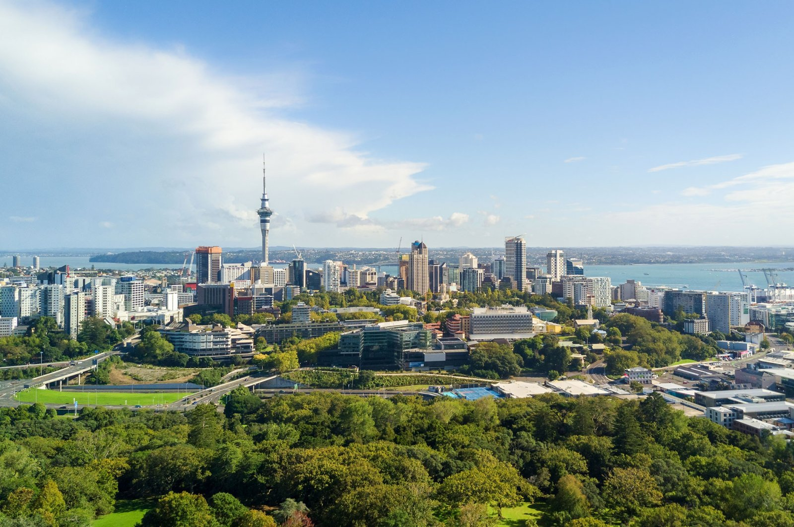 Blue sky breaks through the clouds over Auckland, New Zealand. (Shutterstock Photo)