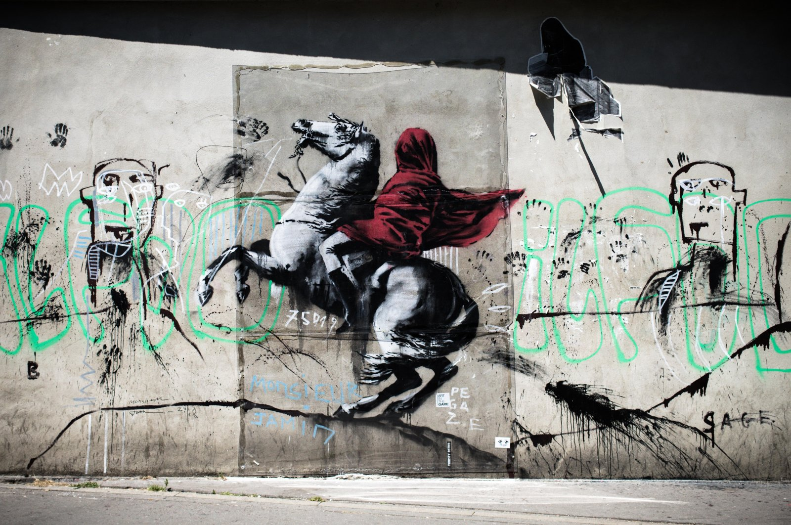 A recent artwork by street artist Banksy of Napoleon Bonaparte wearing a headscarf inspired by the original painting by Jacques-Louis David, Paris, France, June 26, 2018. (Photo by Getty Images)