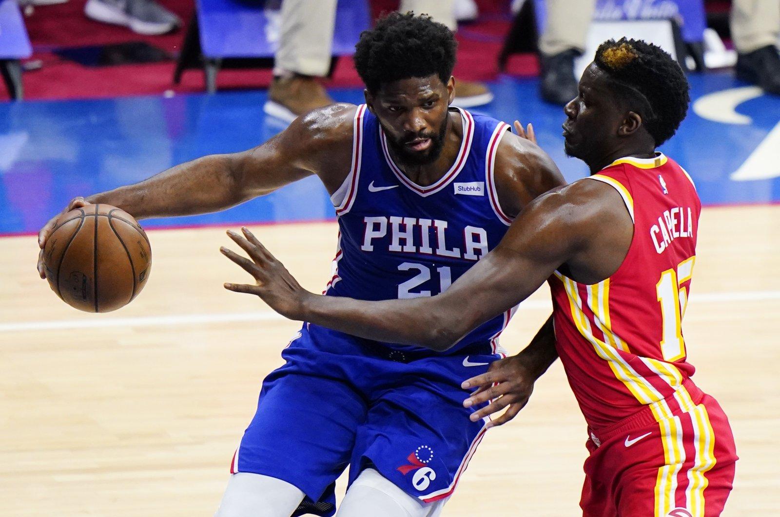 Philadelphia 76ers' Joel Embiid (L) tries to get past Atlanta Hawks' Clint Capela during Game 2 of their second-round NBA Playoffs series, Philadelphia, U.S., June 8, 2021. (AP Photo)