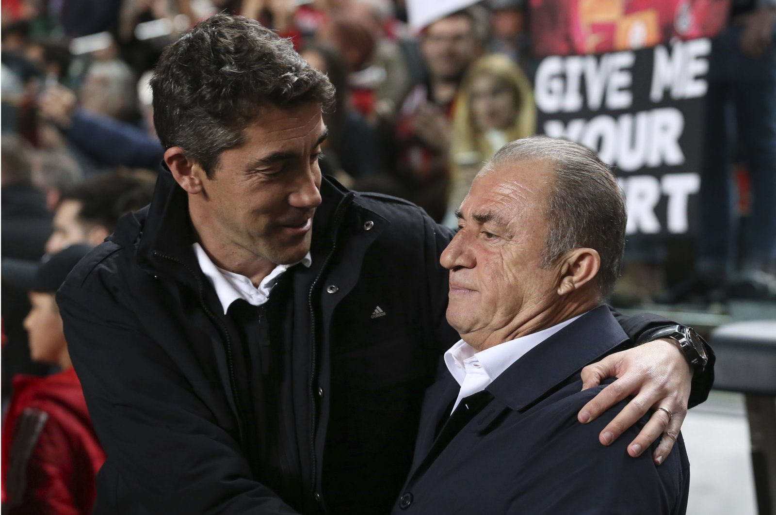 Then-Benfica head coach Bruno Lage (L) greets Galatasaray coach Fatih Terim prior to a Europa League match at the Luz stadium in Lisbon, Portugal, Feb. 21, 2019. (AP Photo)