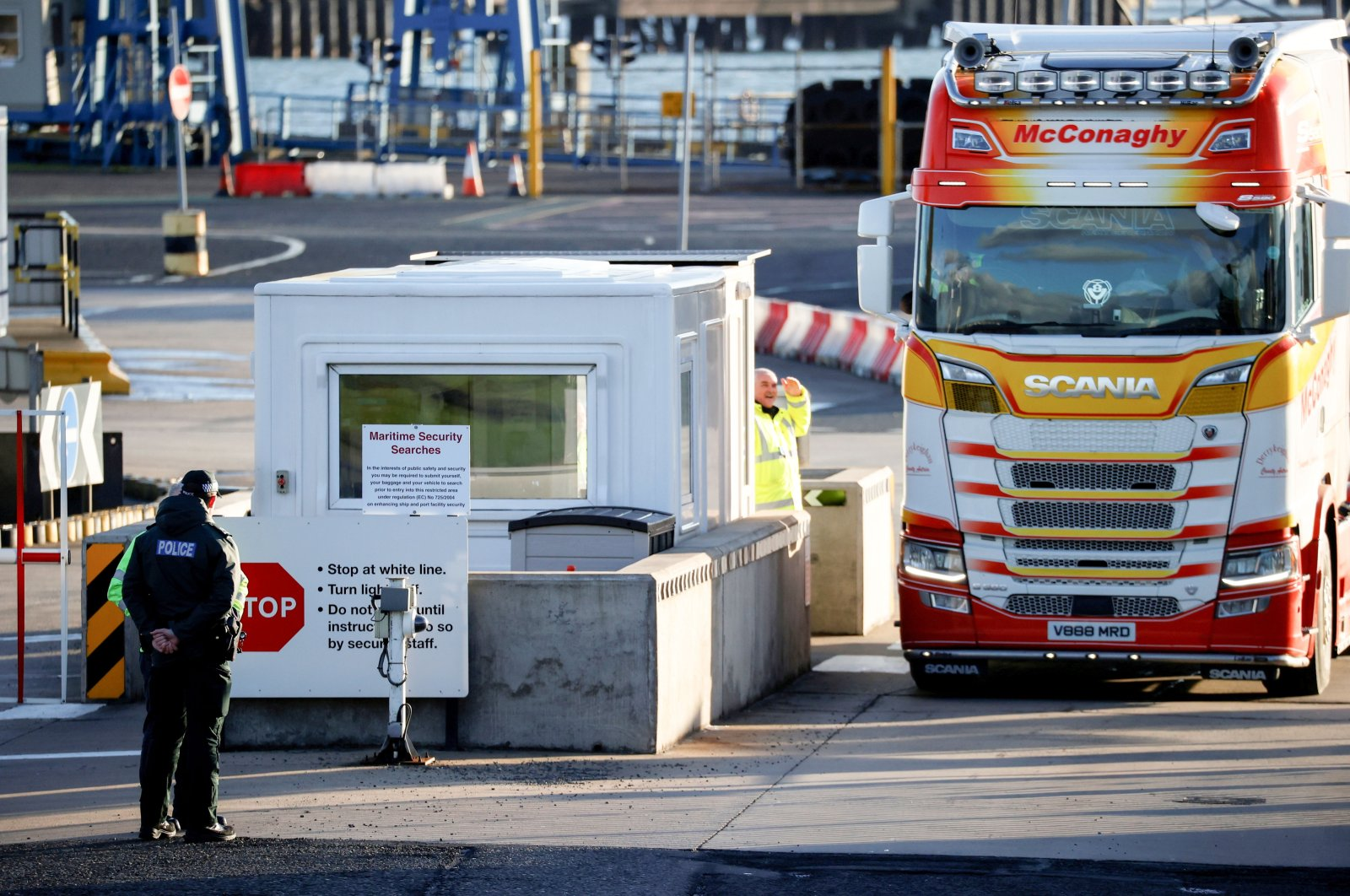 Police officers stand by port security as a lorry drives in at the entrance to the Port of Larne, Northern Ireland, Britain, Jan. 1, 2021. (Reuters Photo)