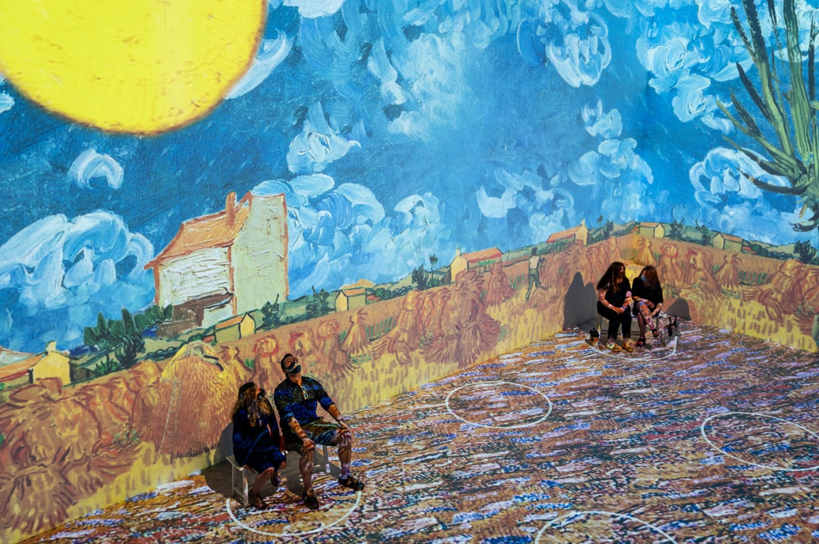 """Projections of selected works of celebrated painter Vincent Van Gogh are displayed at a preview of the """"Immersive Van Gogh"""" exhibit at Pier 36 in New York, U.S., June 4, 2021. (AP Photo)"""